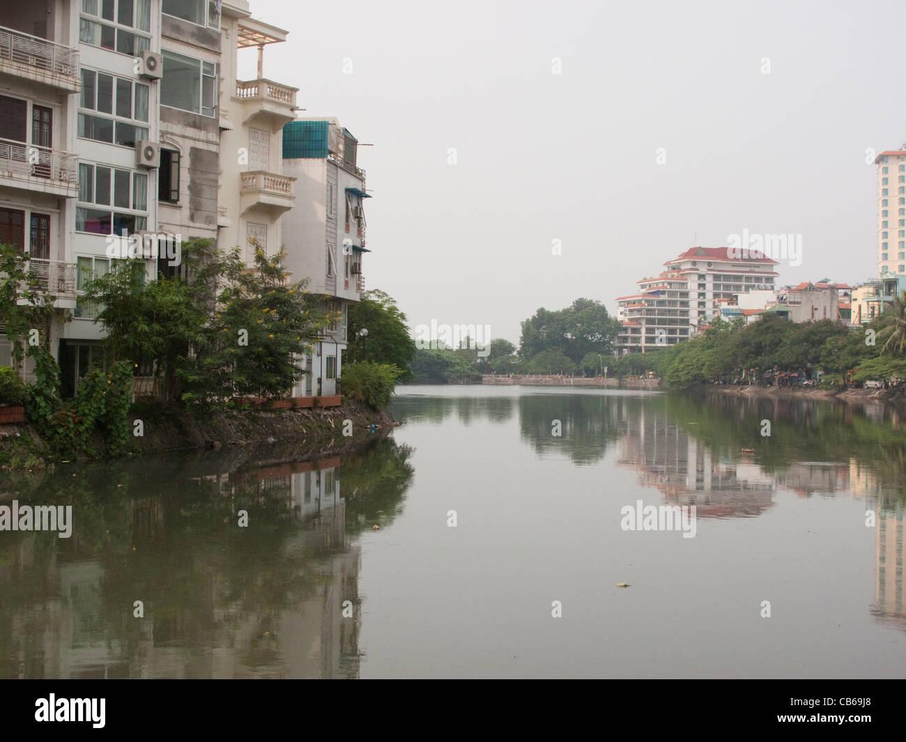 View of houses around Truc Bach Lake in Hanoi, Vietnam - Stock Image