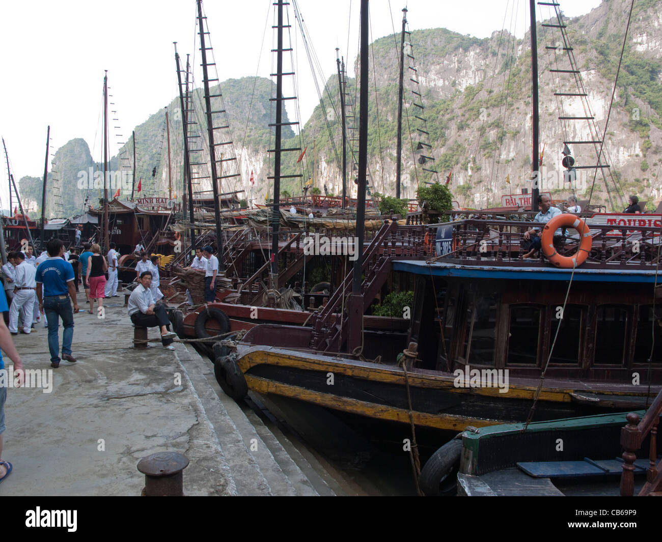 Tourist junk boats moored at Halong Bay in Vietnam - Stock Image