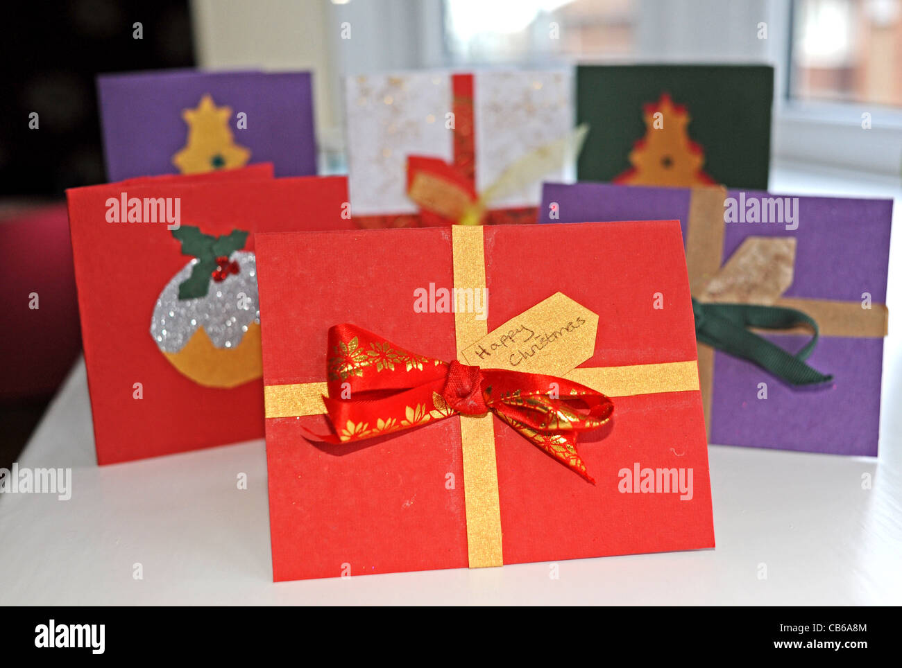 Making Christmas cards by hand using recycled old cards from ...