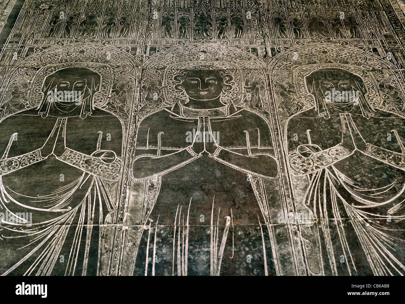 Tomb brass dated 1364. St. Margarets Church, Kings Lynn, England. Robert Braunche and wives Letitia and Margaret. - Stock Image