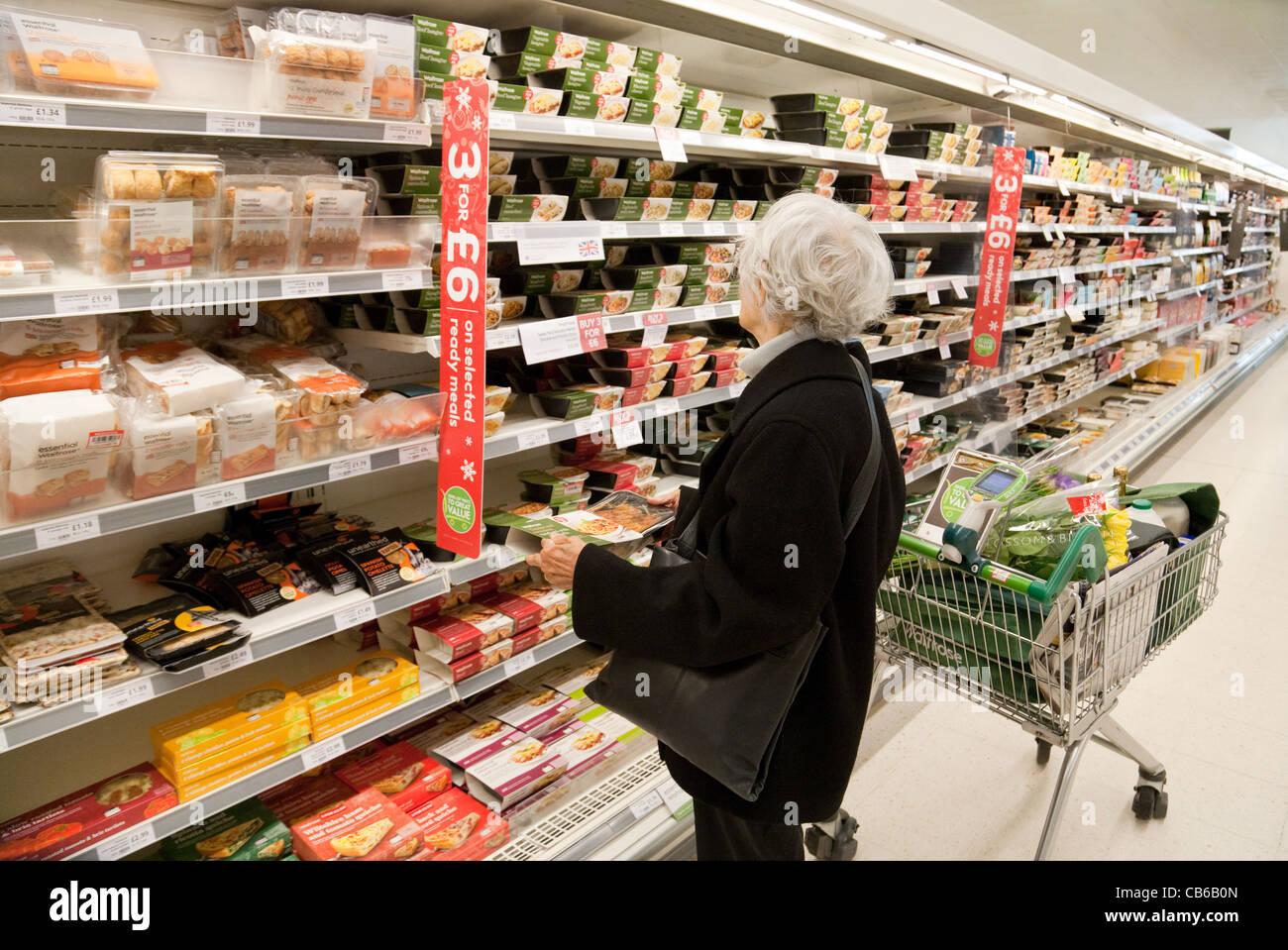 Elderly woman shopping for food in Waitrose supermarket UK - Stock Image