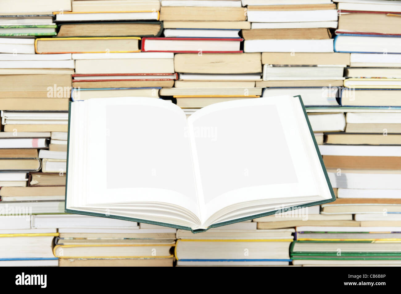 open book on background of arranged books - Stock Image