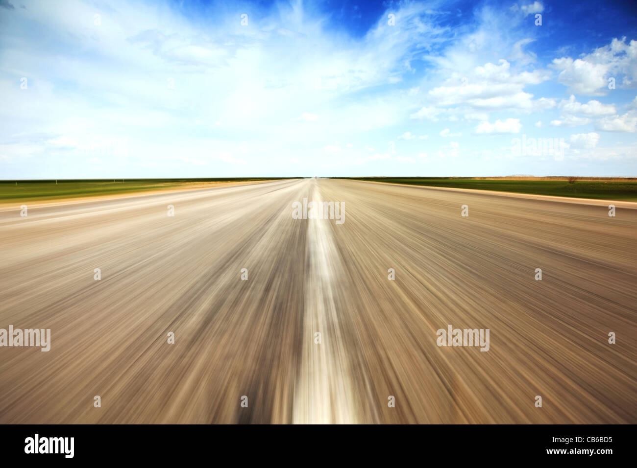 Speed concept. Empty countryside old road stretches in perspective. - Stock Image