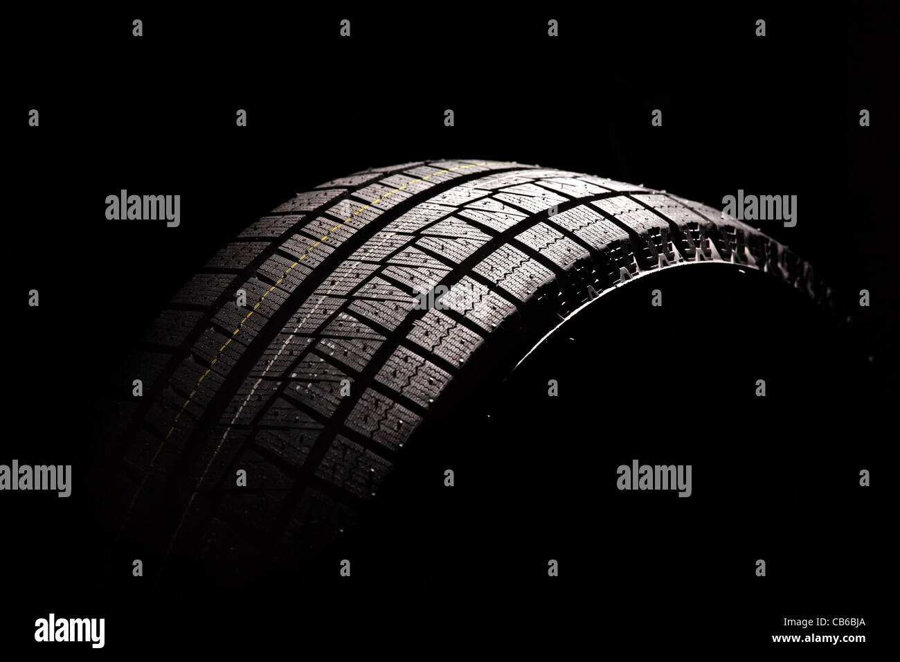 Brand new car tyre. Isolated on a white backgrond. - Stock Image