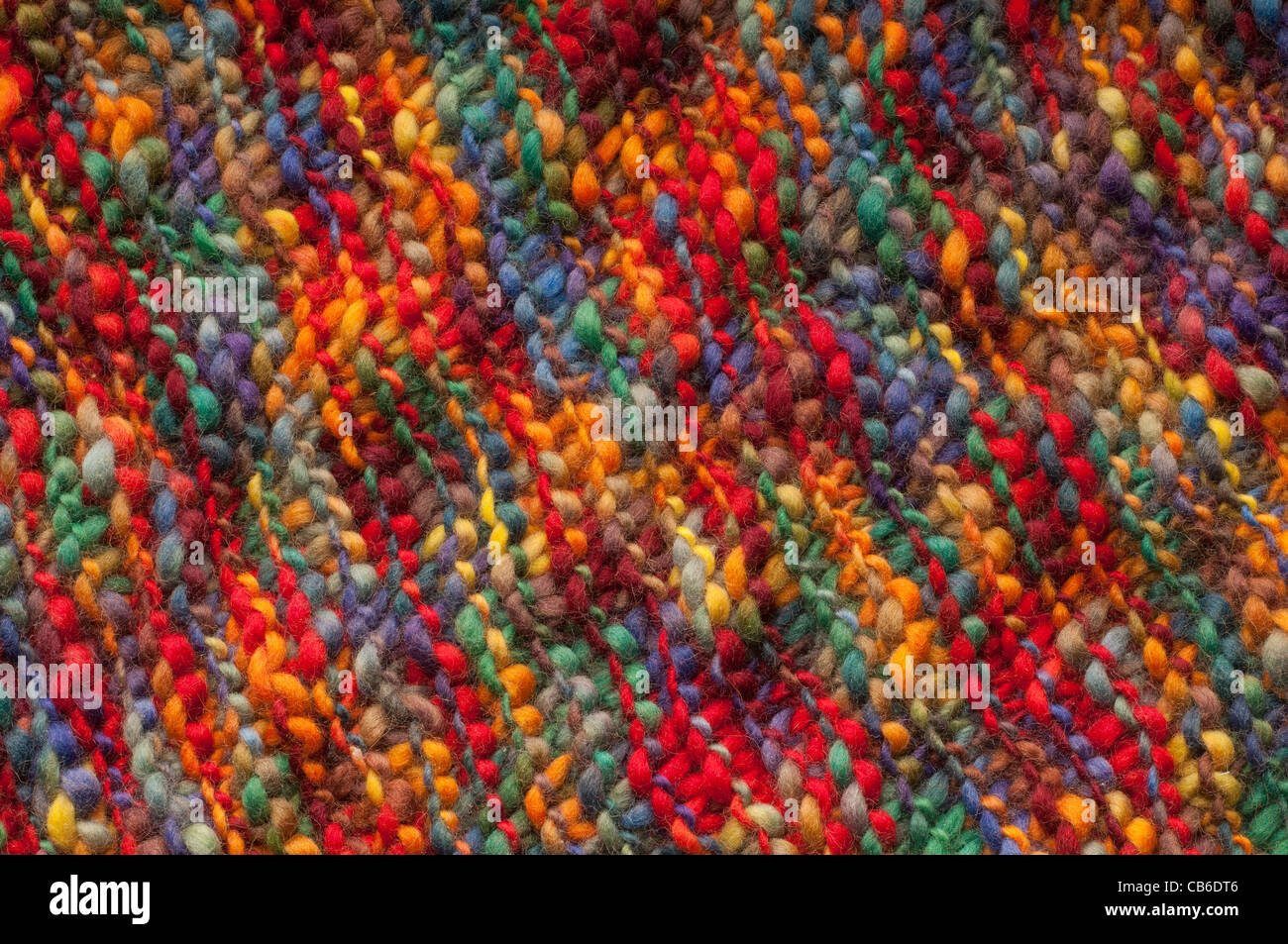 natural wool fabric with colorful hand made - Stock Image
