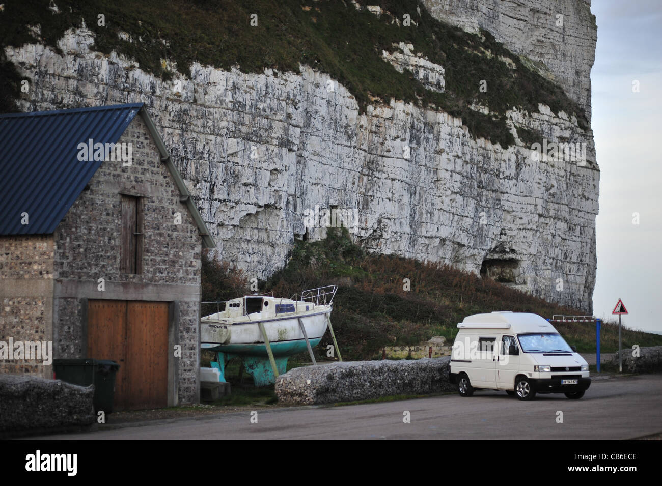 Normandy, Saint Valery en Caux town, camper on seaside,  falling rocks road sign, at dawn - Stock Image