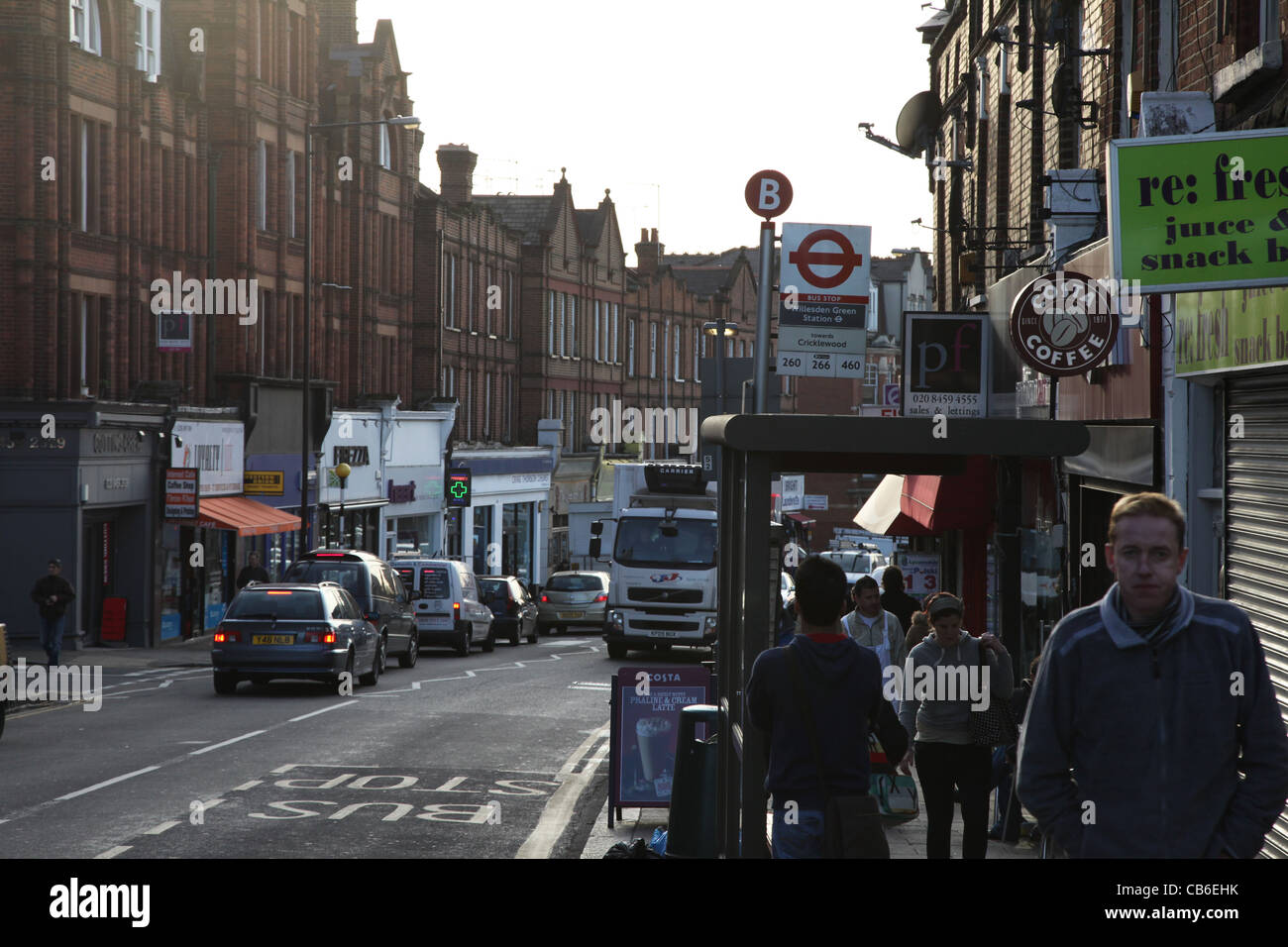 Willesden Green shops and bus stop outside the Underground Station - Stock Image