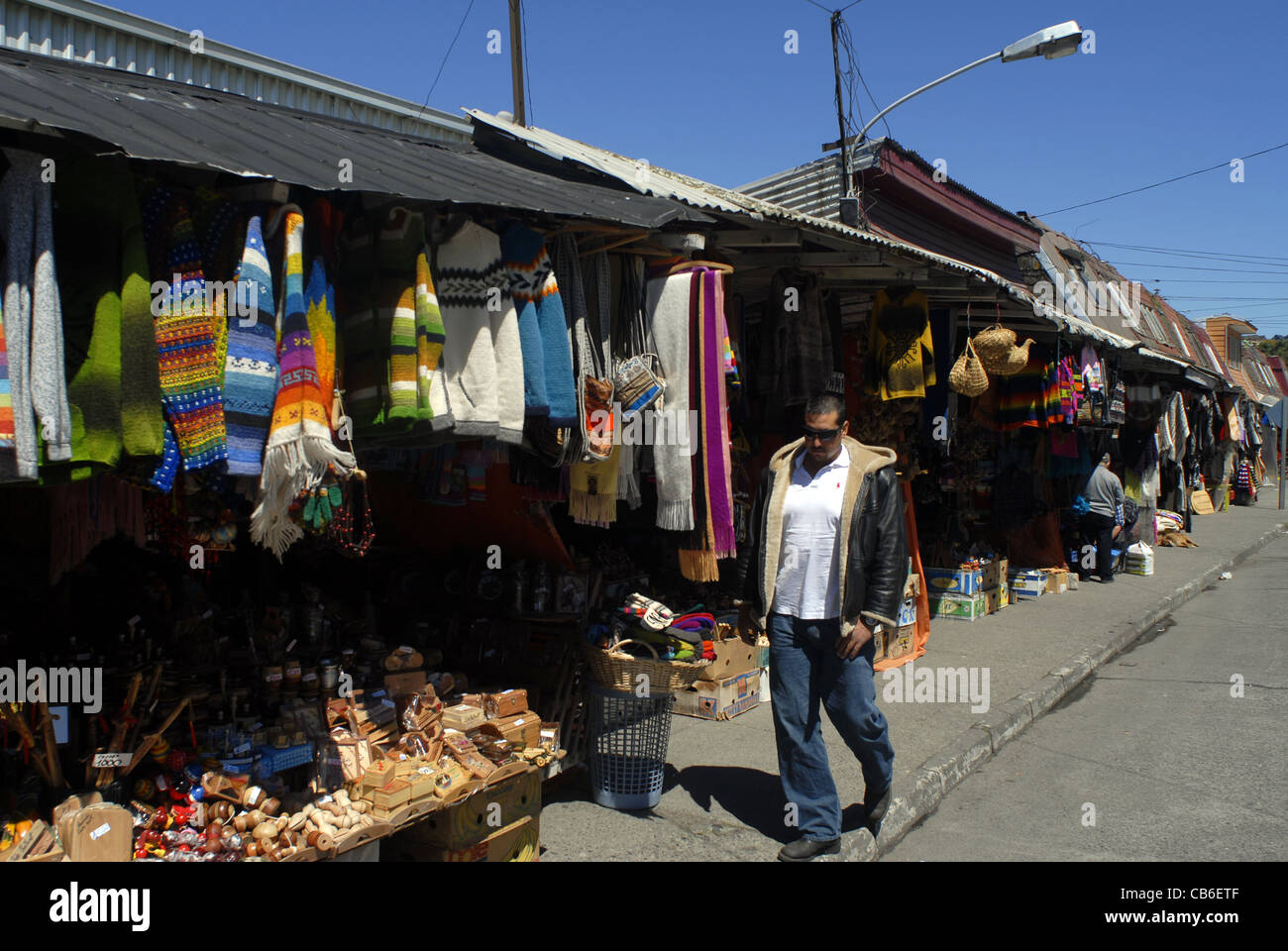 Man at the handcraft Market. Puerto Montt, Lake's District, Chile - Stock Image