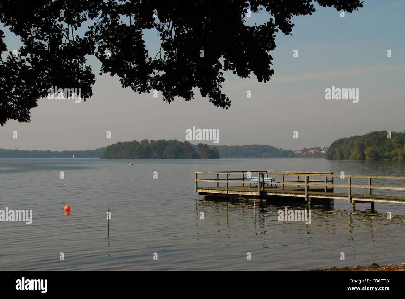Bathing and boating pier at Großer Plöner See, largest of the lakes near Plön in Schleswig-Holstein, - Stock Image