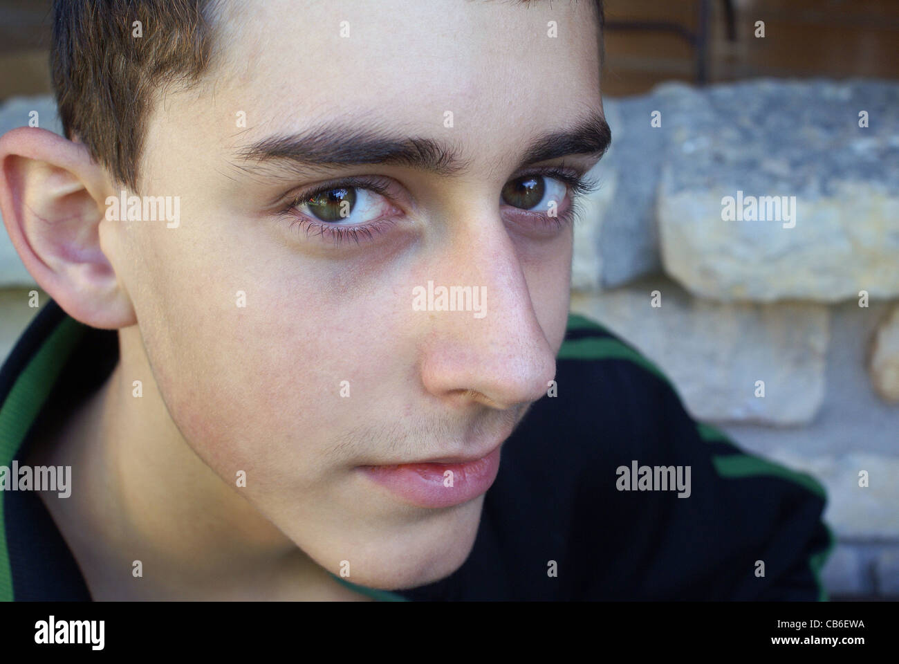 Face of the future in a young teenager. - Stock Image