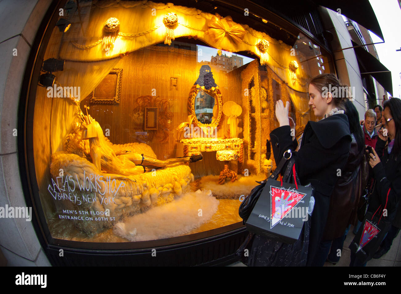 Shoppers view the Barney\'s Christmas window display, Gaga\'s Workshop ...