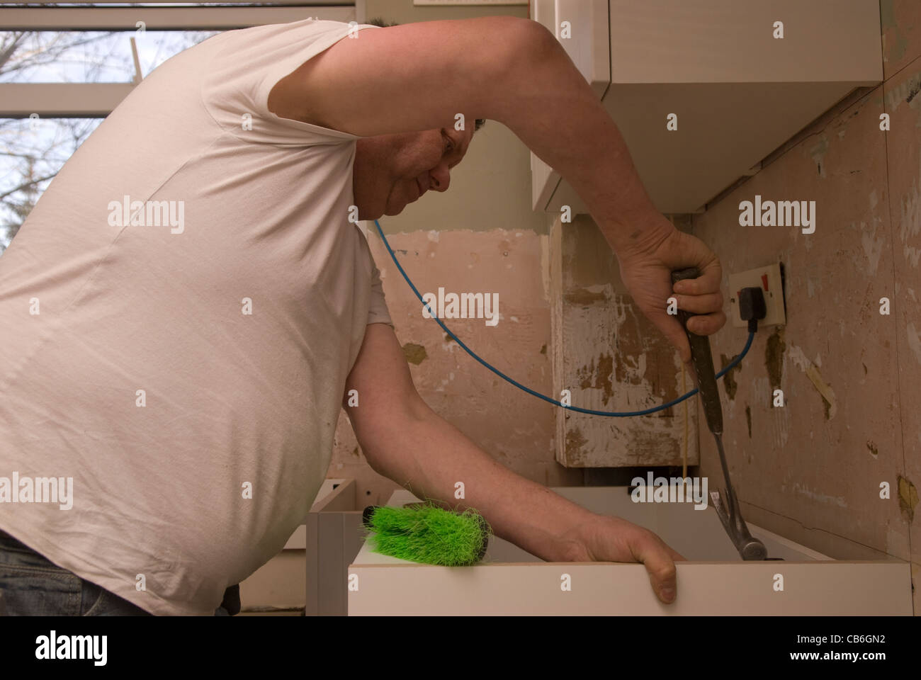 Kitchen Hammer Stock Photos Images Alamy New Home Electrical Wiring Tradesman Using To Position Worktop For Installation In Residential Bordon