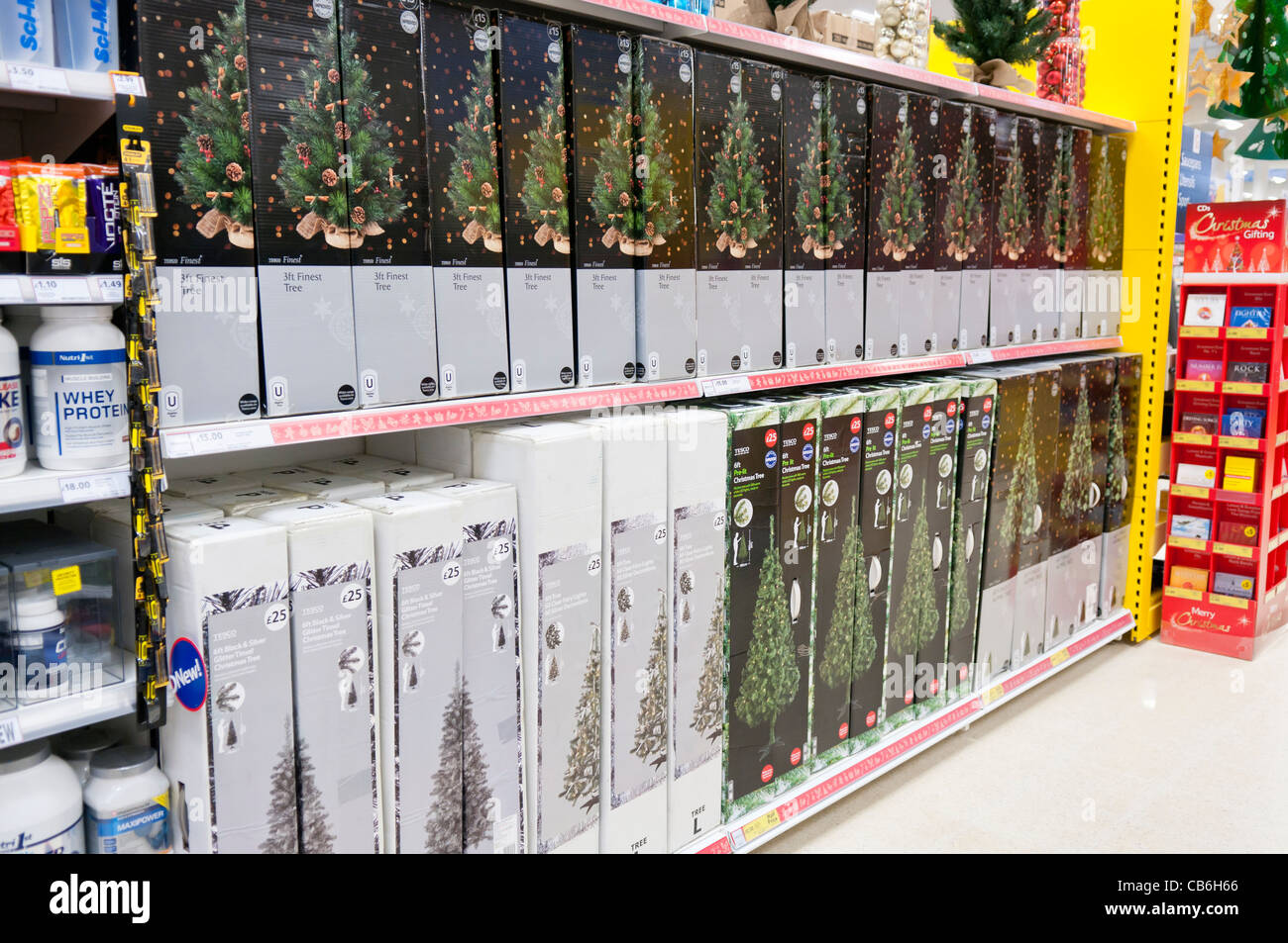 Christmas Trees For Sale On Shelves In A Tesco Store Stock