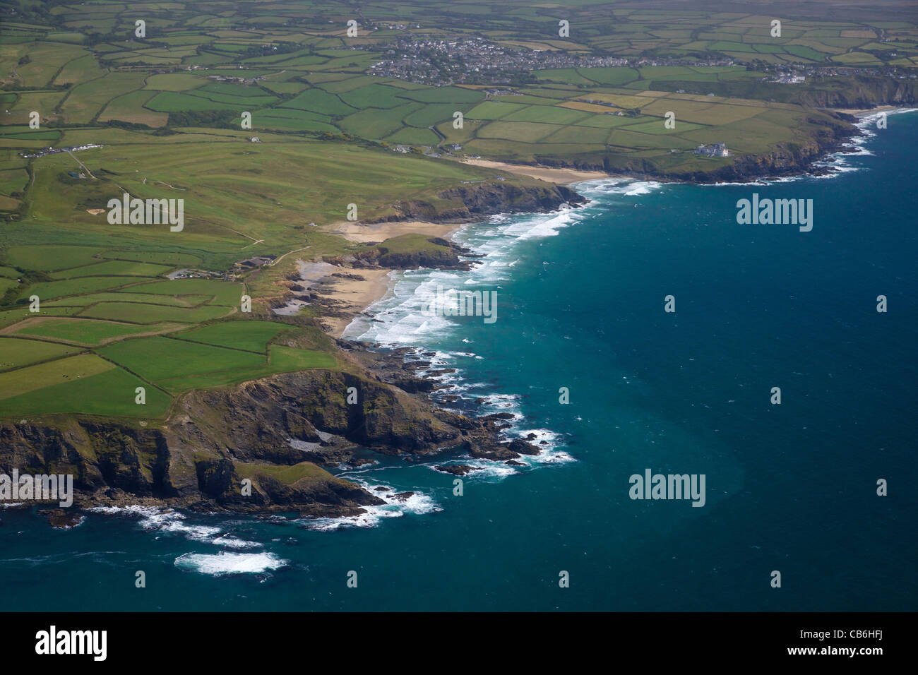 Aerial view of Poldhu Cove looking south to Mullion, Lizard Peninsula, in summer sun, Cornwall,Southwest  England, - Stock Image