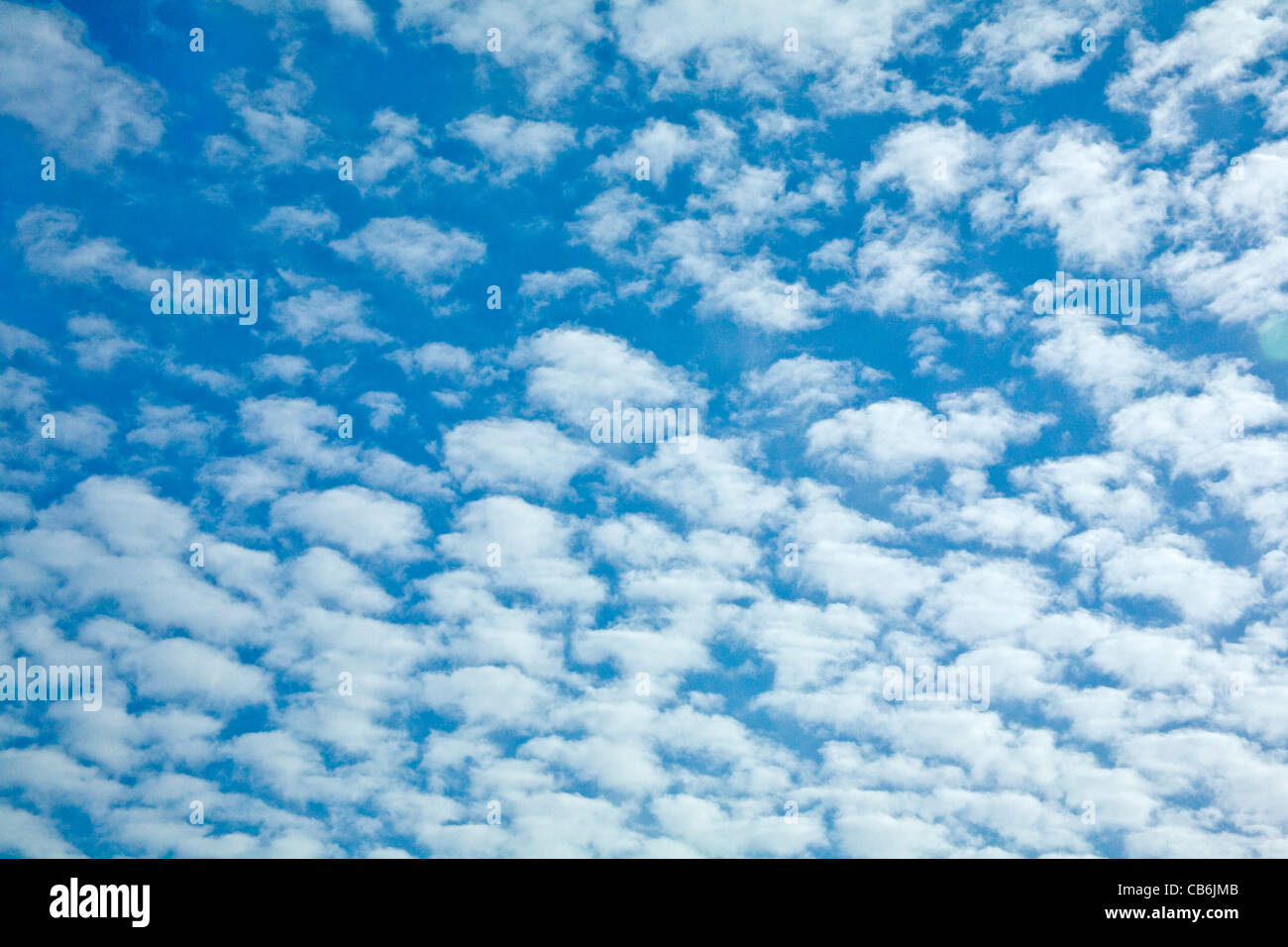 Fluffy clouds on blue sky - background - Stock Image