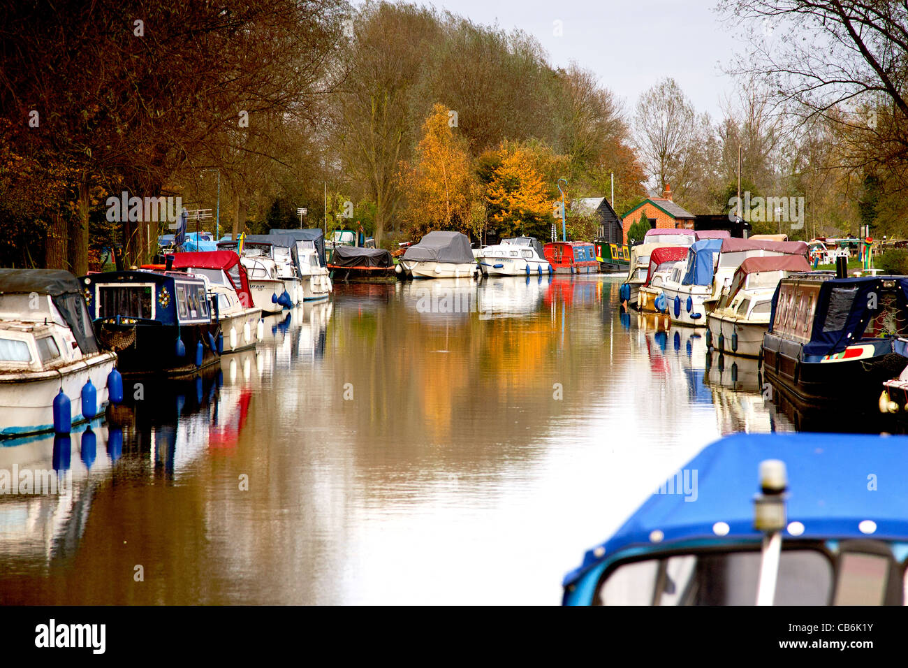 papermill lock in Chelmsford with leisure craft moored along the bank - Stock Image