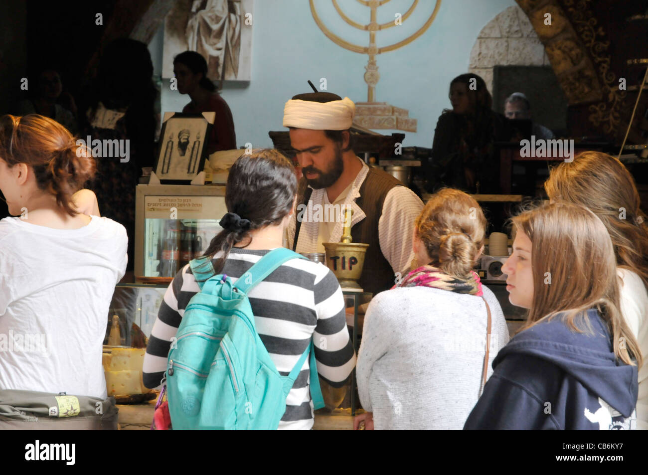 Young girl tourists ordered coffee in exotic street cafe, Safed, Galilee, Israel,Asia, Middle East - Stock Image