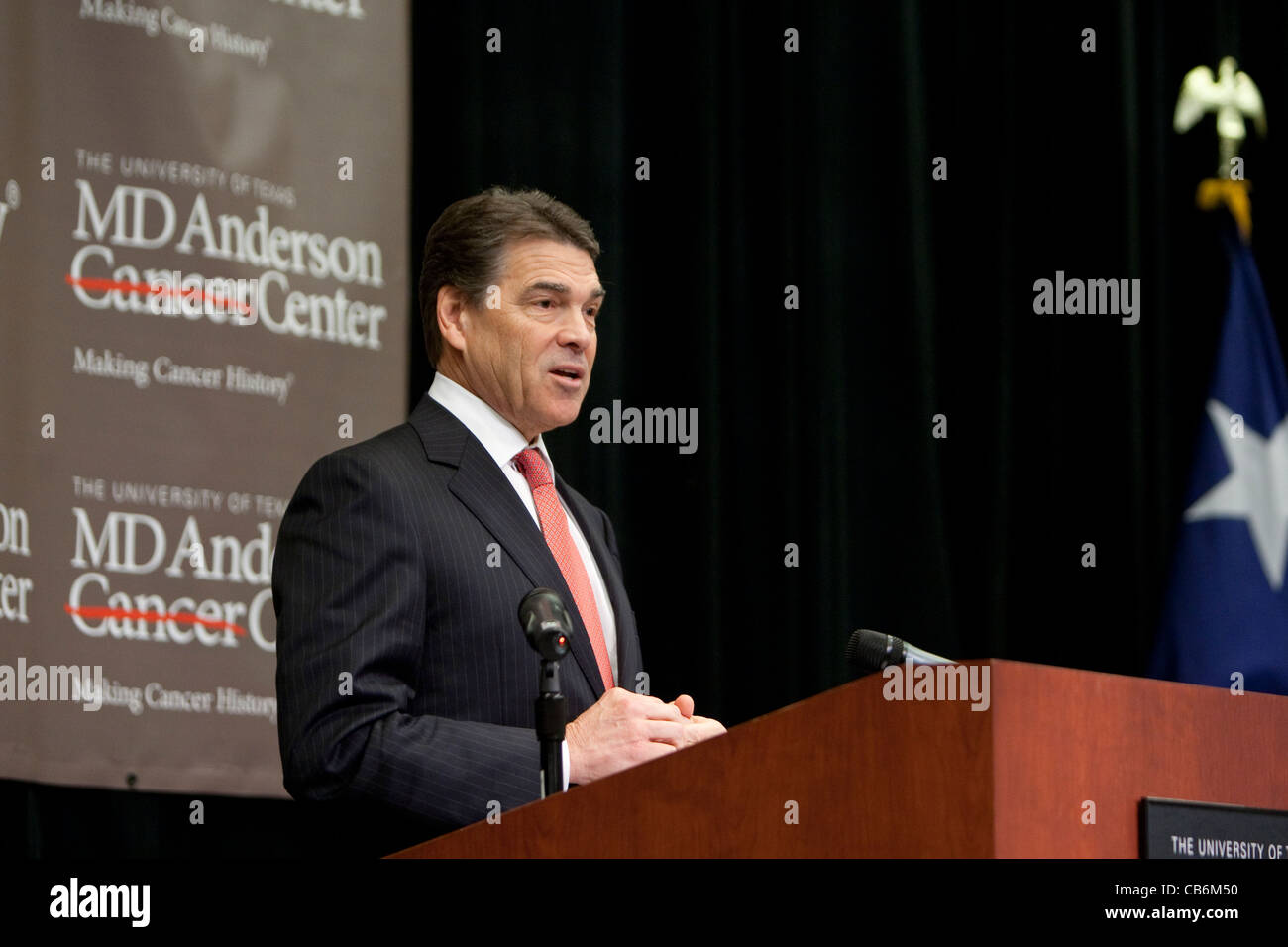 Texas Governor Rick Perry speaks at the announcement of a cancer initiative at M.D. Anderson Hospital in Houston, - Stock Image