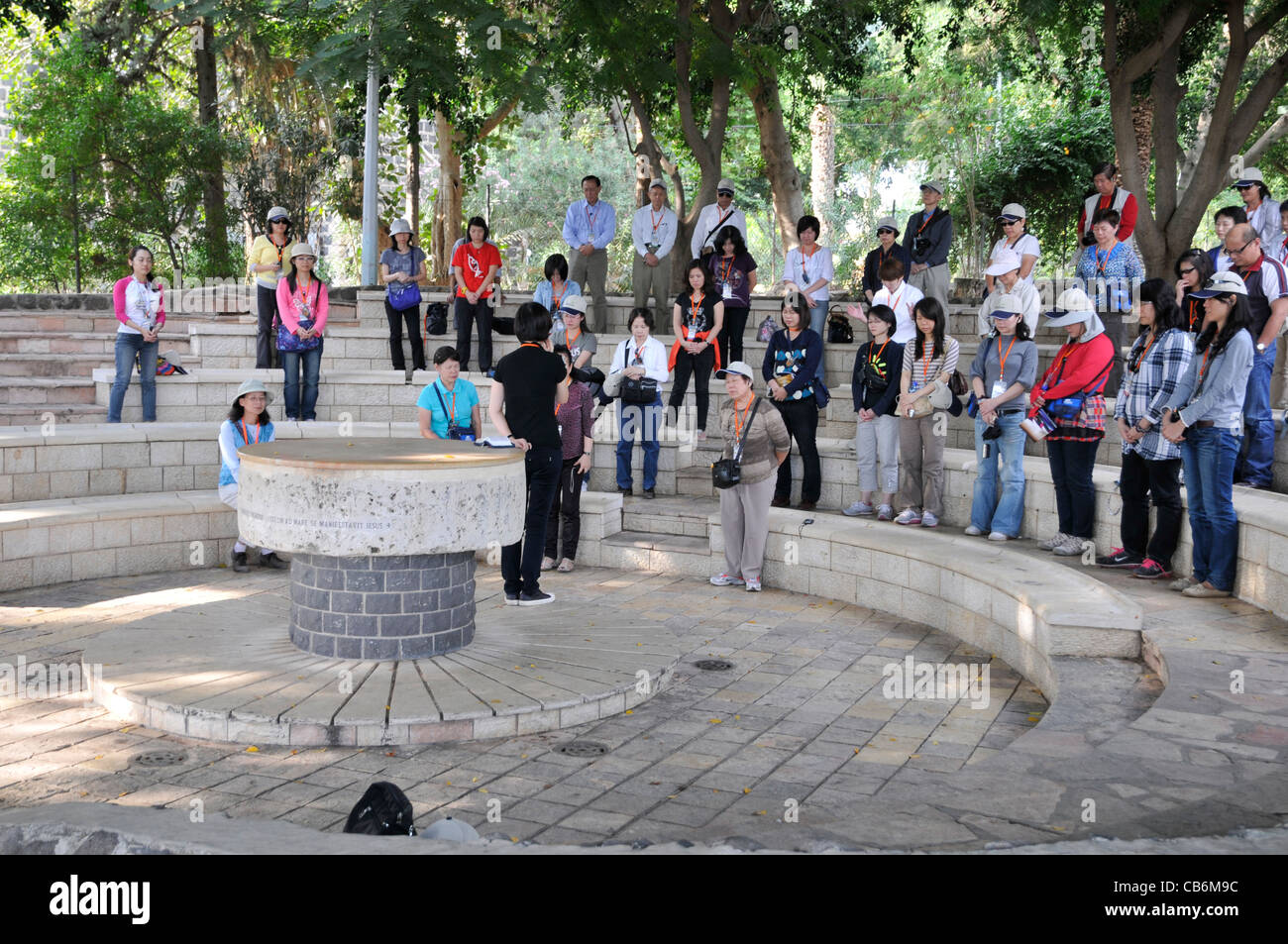 Pilgrims praying near Church of the Primacy of Peter in Tabgha, Galilee, Israel, Asia,  Middle East - Stock Image