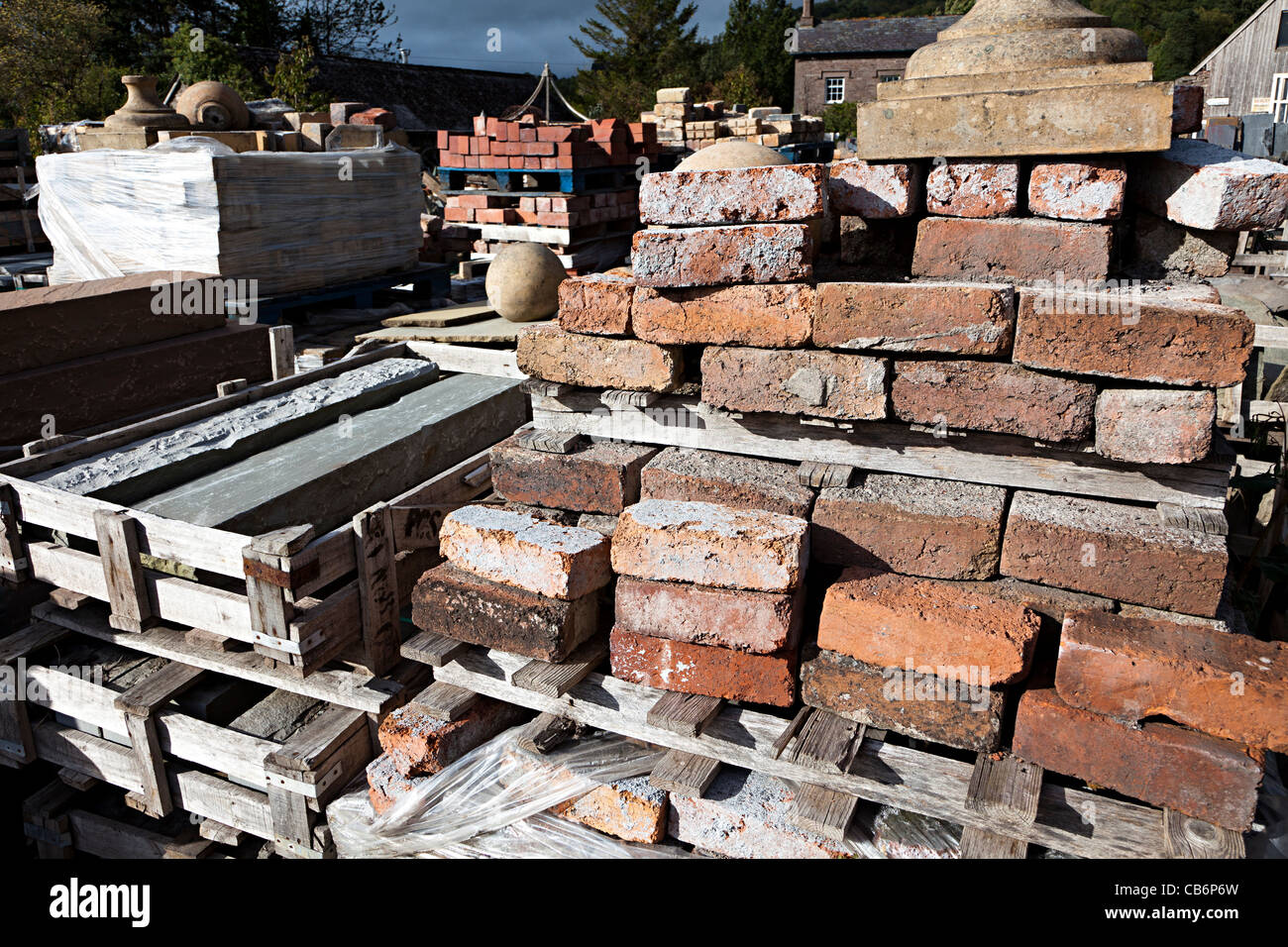 Old bricks in architectural salvage yard Wales UK - Stock Image