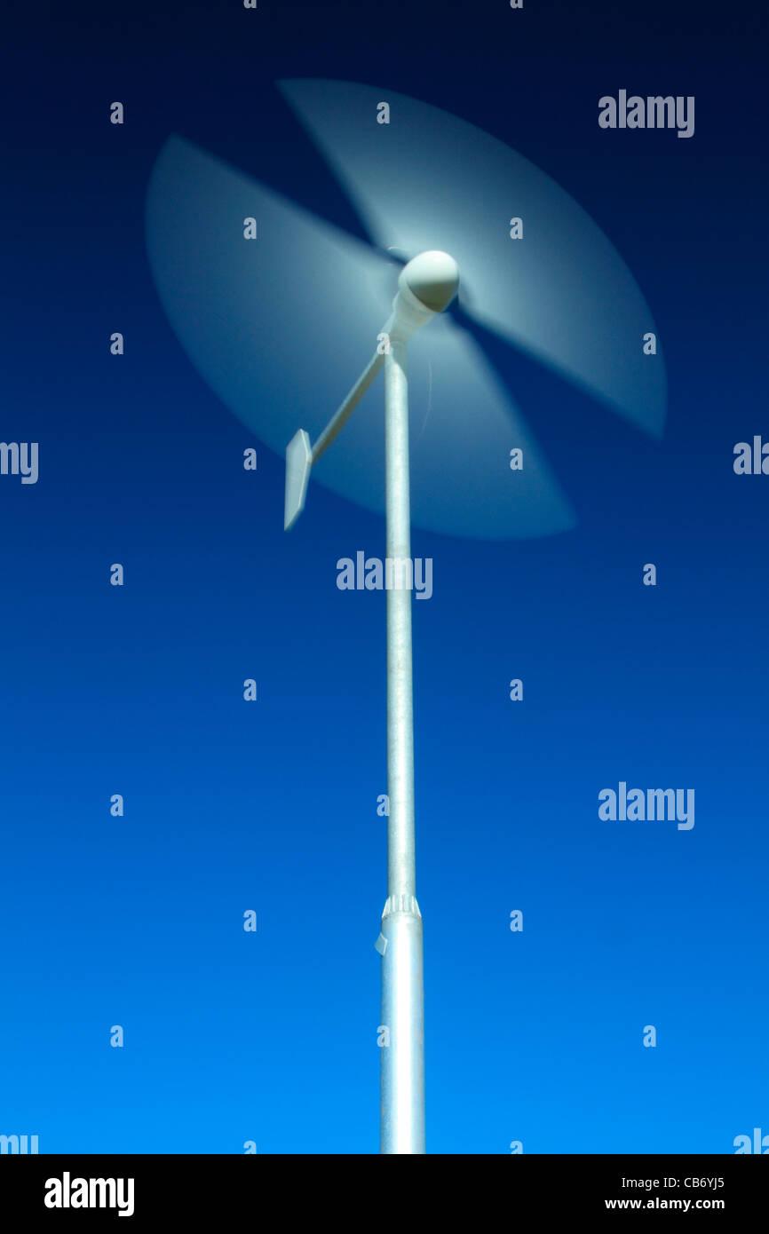 Motion blur of wind turbine blades - Stock Image
