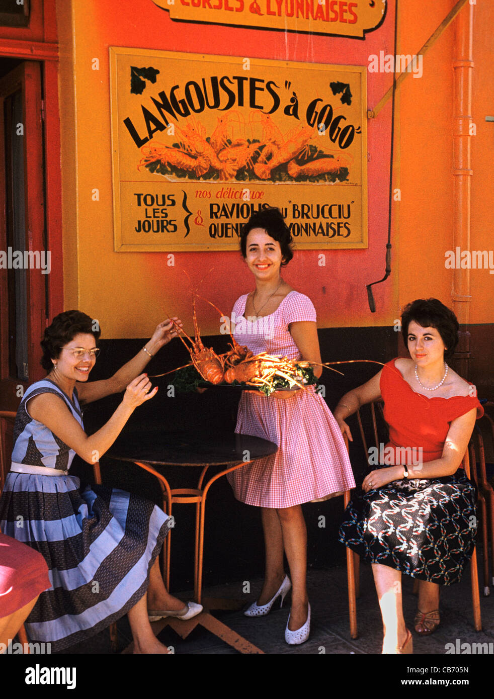 French Women 1950s or early 1960s Outside a Seafood Restaurant Specializing in Lobster, Porto Vecchio, Corsica, - Stock Image