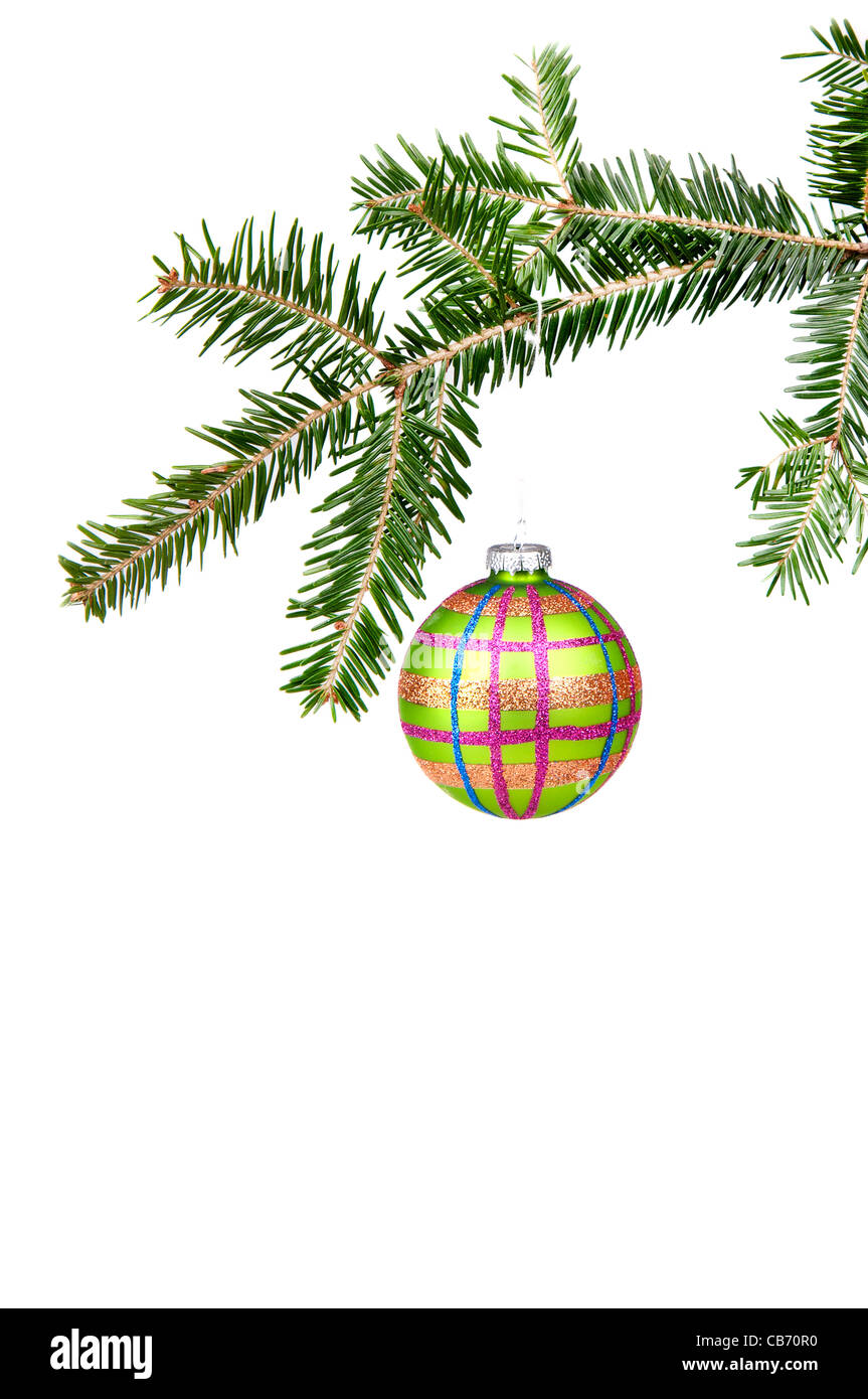 Green glass ball hung on the Christmas tree. On the white background. - Stock Image
