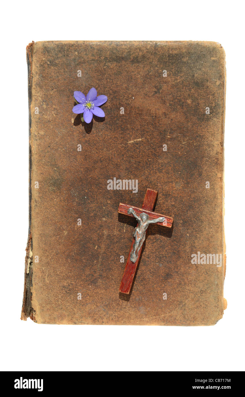 Isolated Old Bible Cover With Crucifixion And Flower
