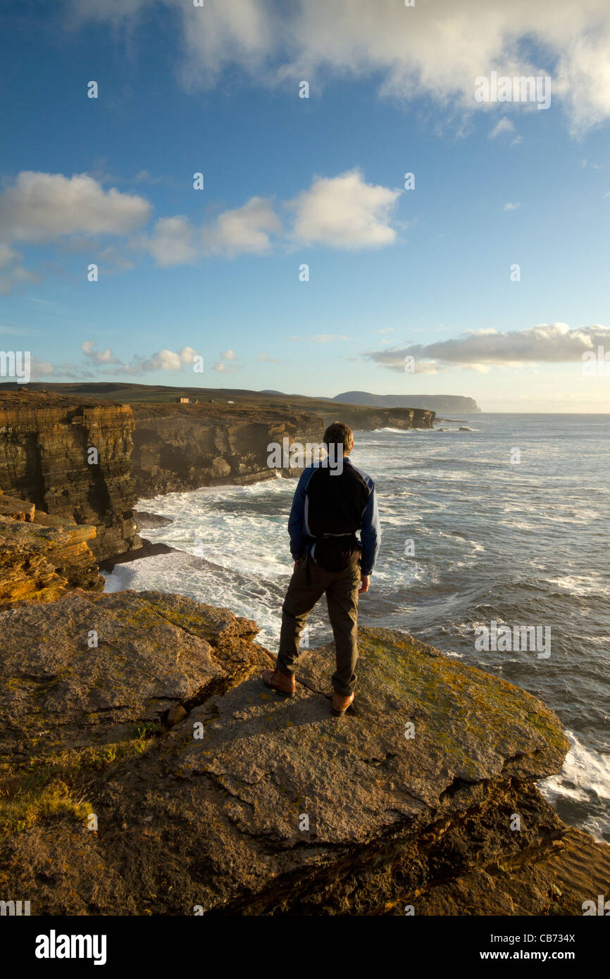 Hiking on the Yesnaby cliffs, Orkney - Stock Image