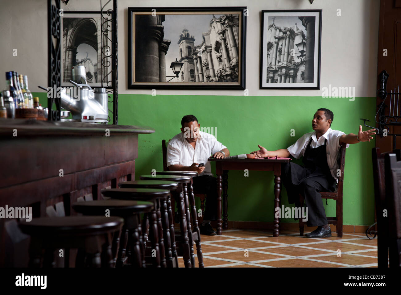 Waiters at conversation in the early afternoon, Havana (La Habana), Cuba - Stock Image