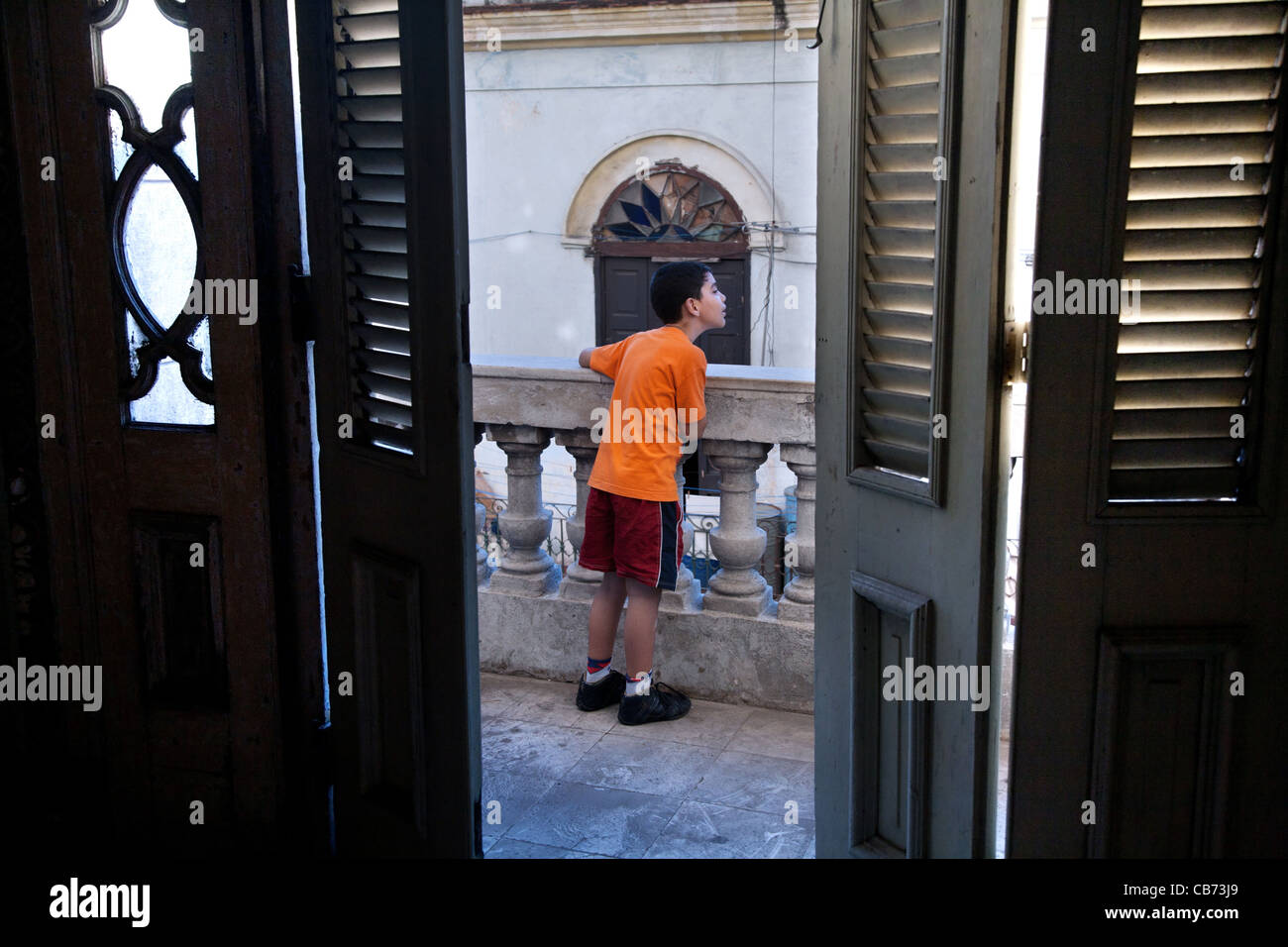 A young boy by a balcony at the National Theatre of Havana, Havana (La Habana), Cuba - Stock Image