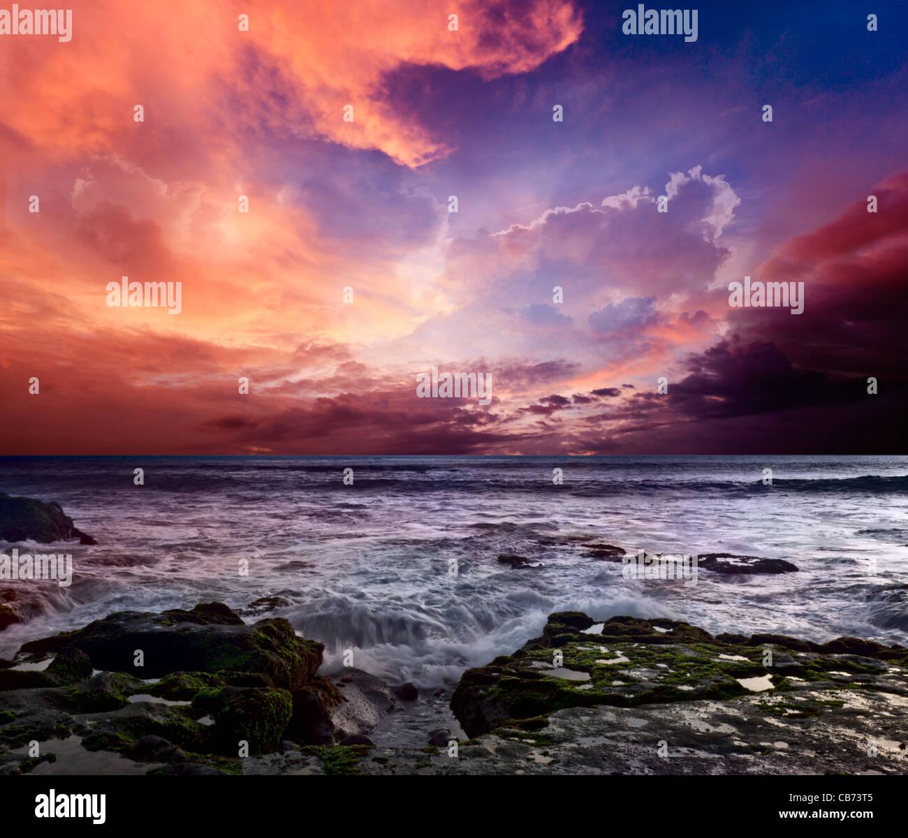 Rocky coast. Sunset - Stock Image