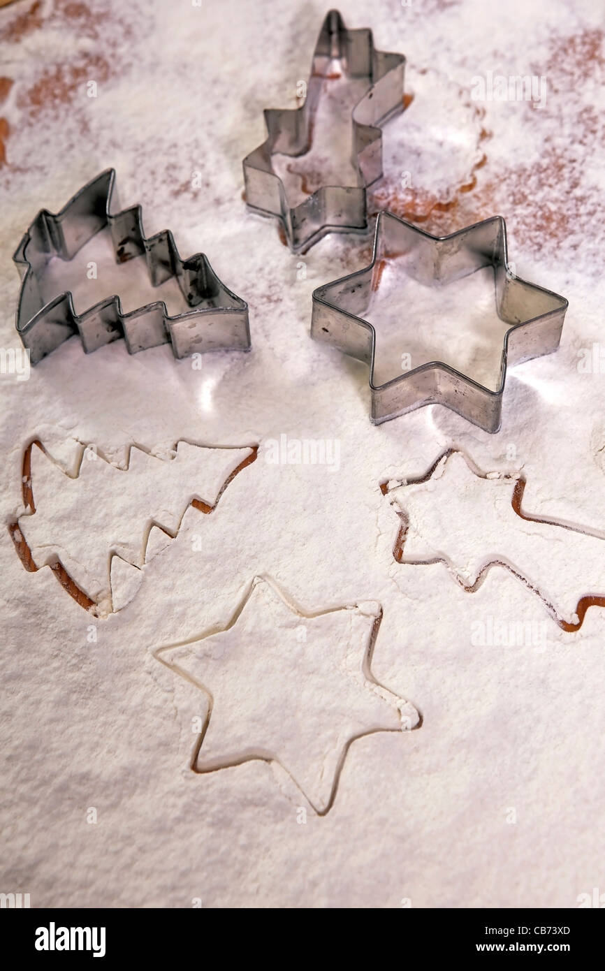 Cookie cutters in flour - Stock Image