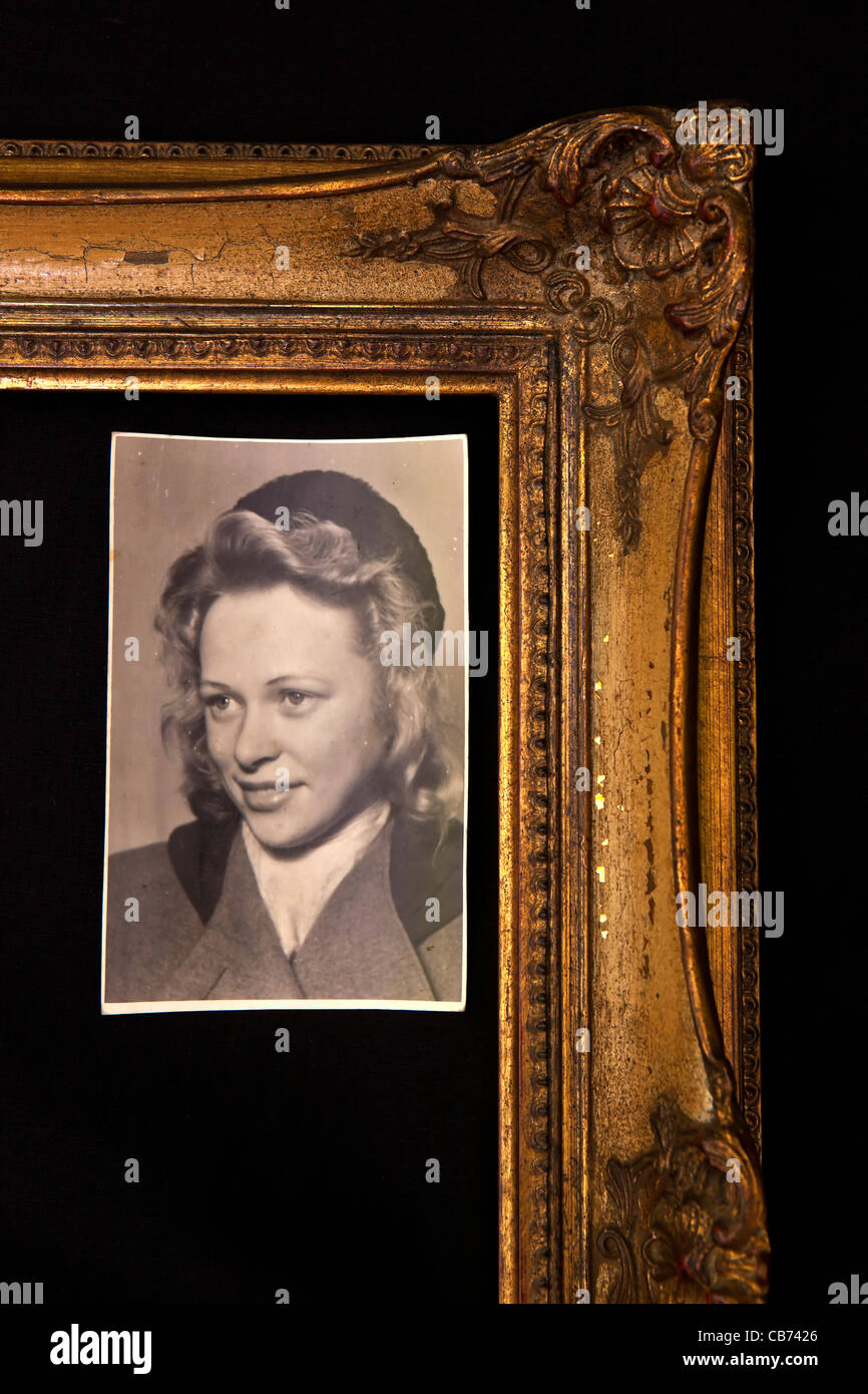an old photo of a young woman from the 1940s in an old picture frame - Stock Image