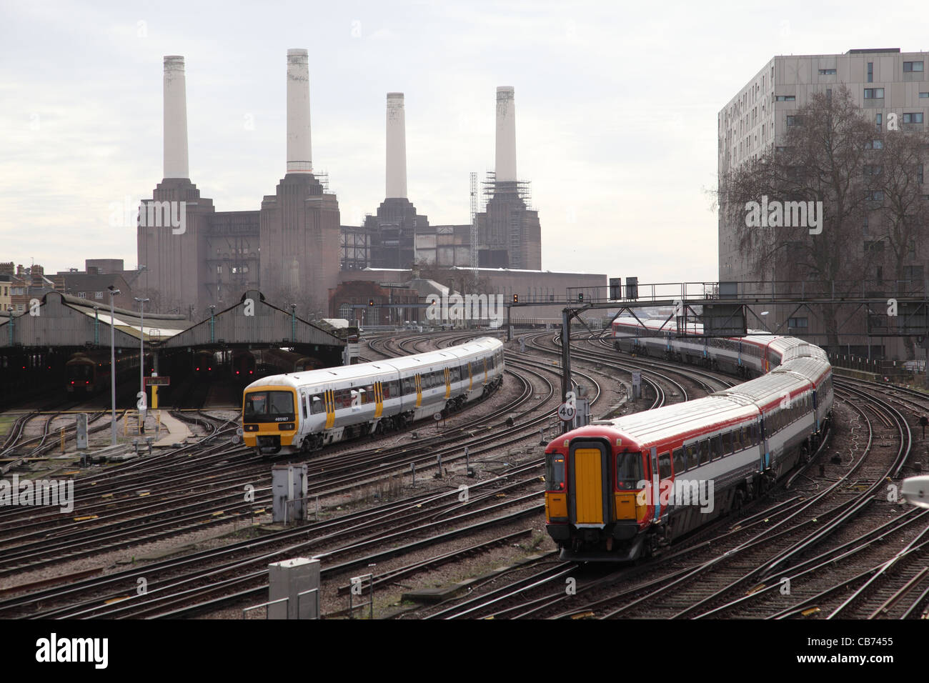 Railway Lines near London's Victoria Station with Battersea Power Station in the Background - Stock Image