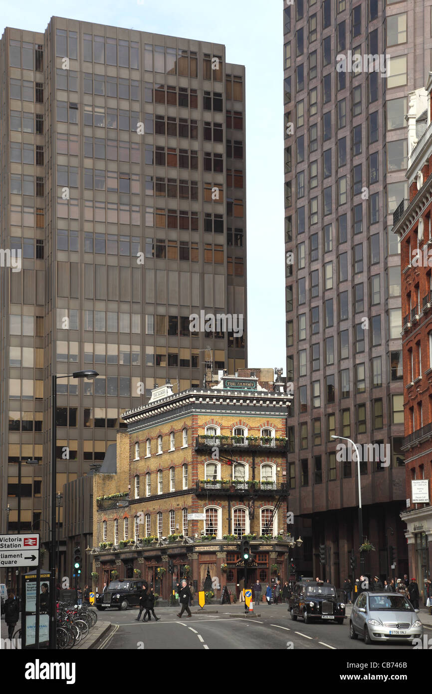 The Albert on Victoria Street, A traditional, Victorian  London Pub dwarfed by modern tower blocks - Stock Image