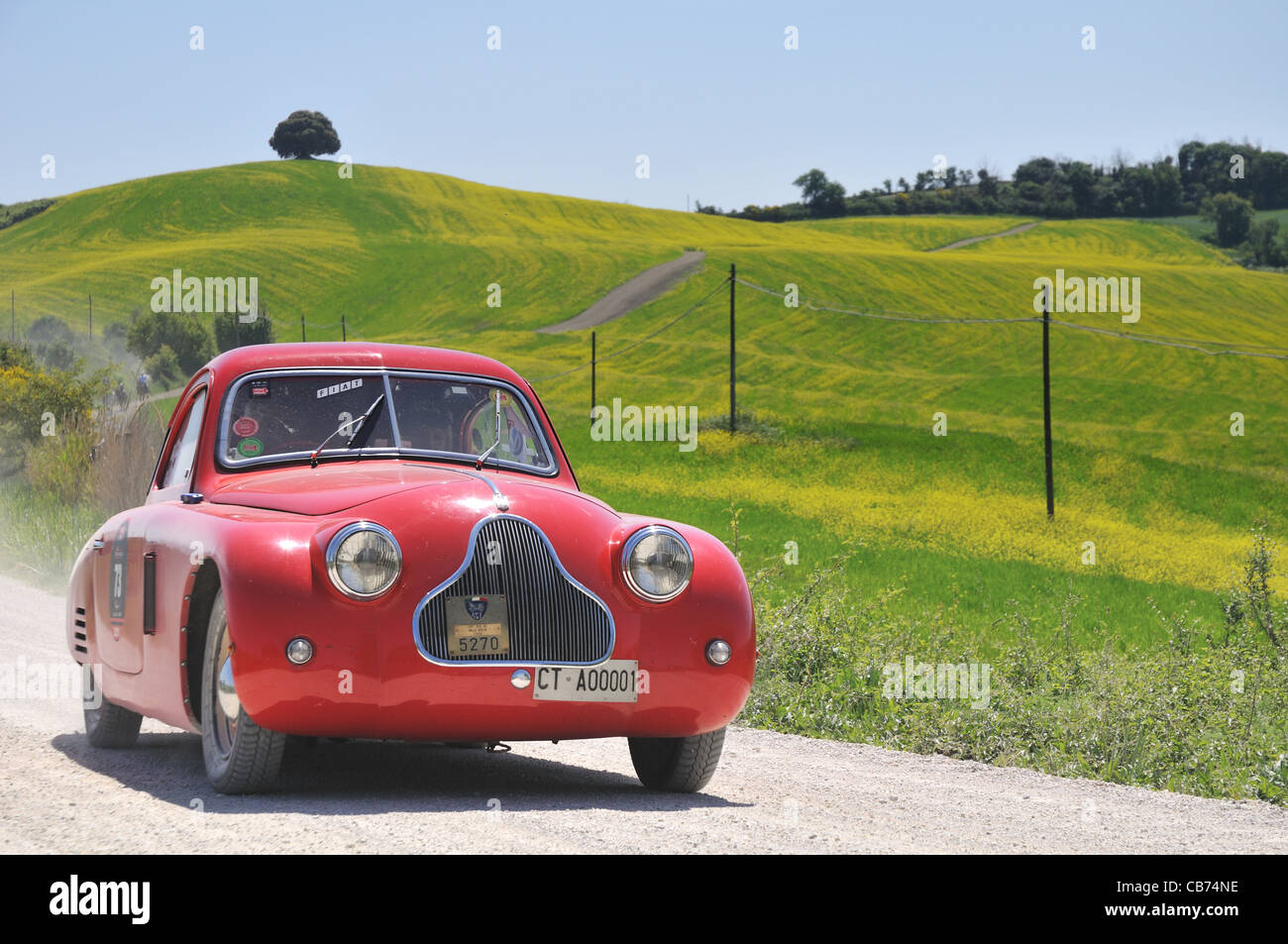 A 1938 red Fiat 508 CS MM at 1000 Miglia vintage car race - Stock Image