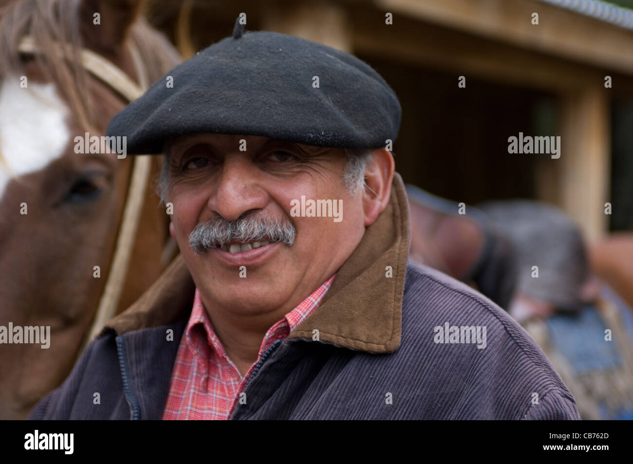 A gaucho, one of the traditional cowboys of Chile's Patagonia, with the customary mustache and traditional beret. - Stock Image