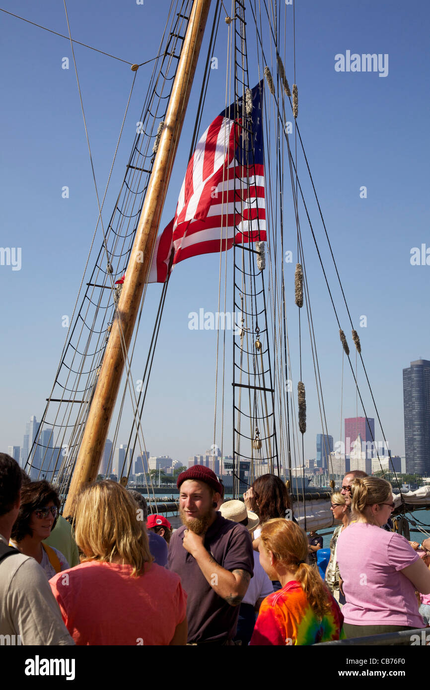 Tourists waiting to board tall ship Friends Good Will. Bearded man is crew member. Tall Ships 2011, Navy Pier, Chicago, - Stock Image