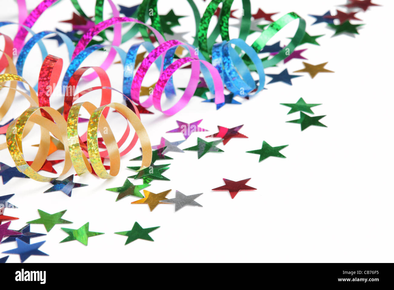 Colorful streamers and confetti on a white background - Stock Image