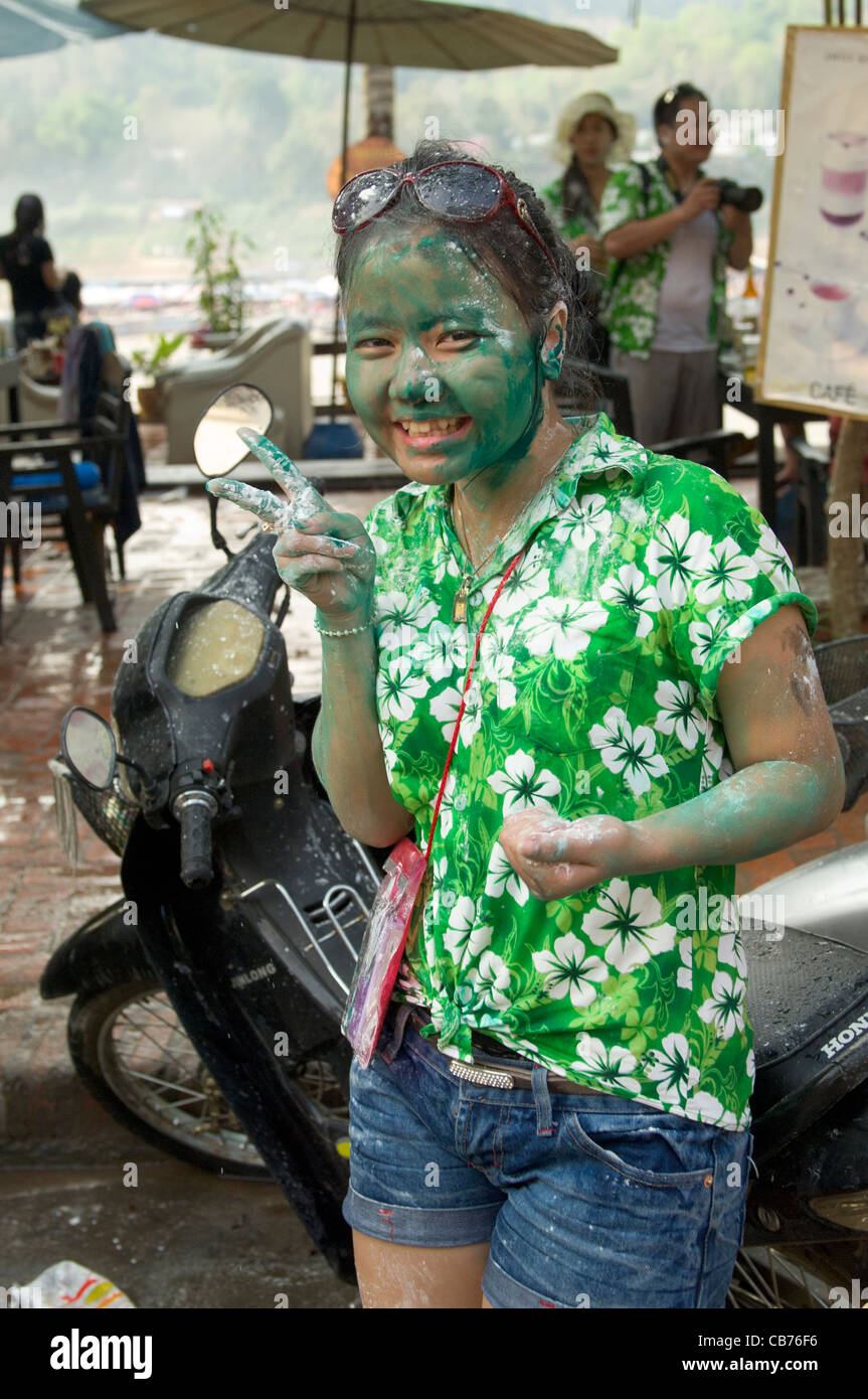 Girl with face covered in green paint during a water-fight to celebrate Lao New Year (Pi Mai Lao), Luang Prabang, - Stock Image