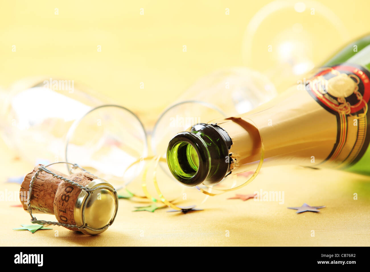 Champagne bottle with empty glasses,Shallow Dof. Stock Photo