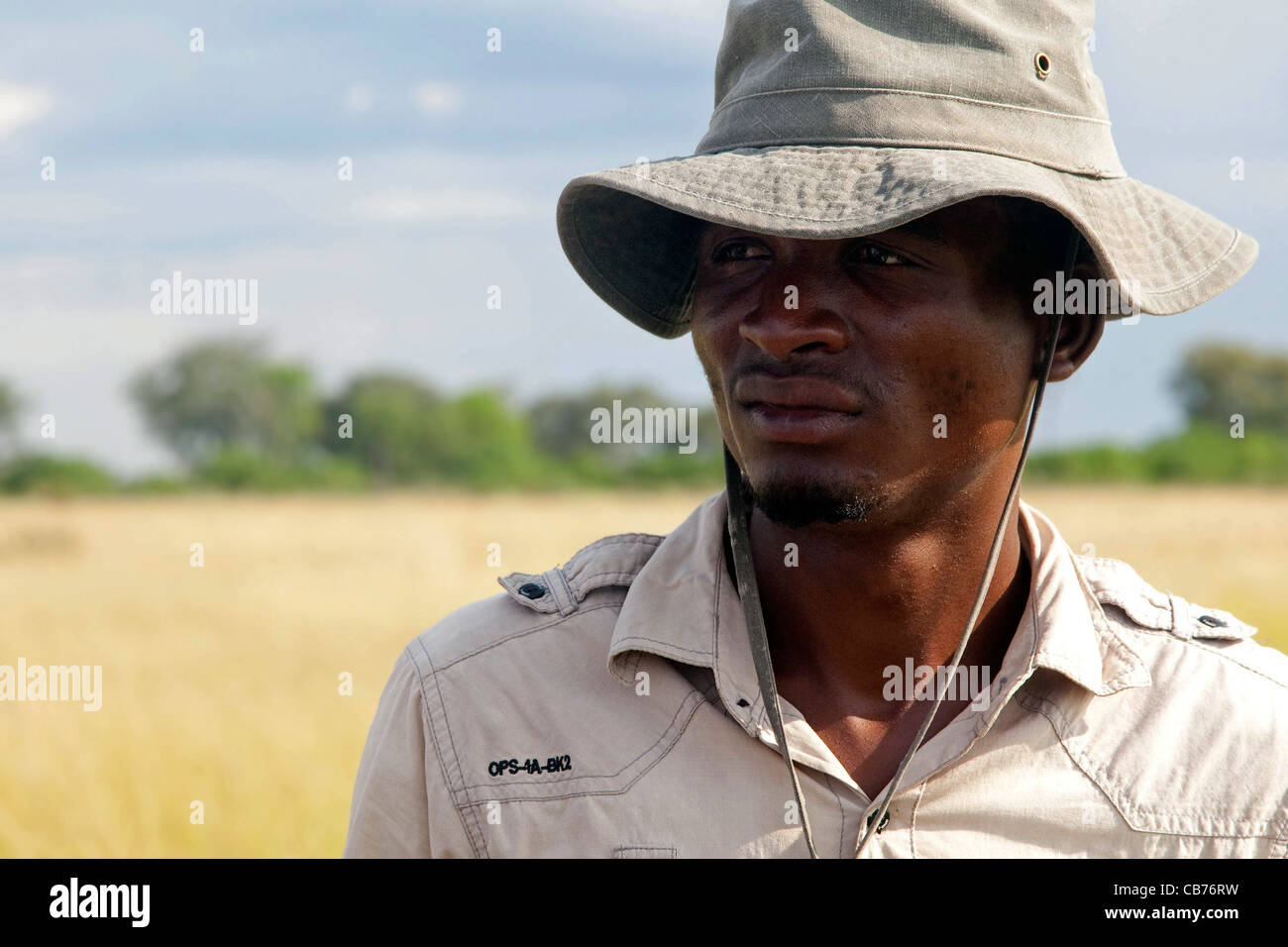 Local African safari guide in the Okavango Delta, Botswana, Africa - Stock Image