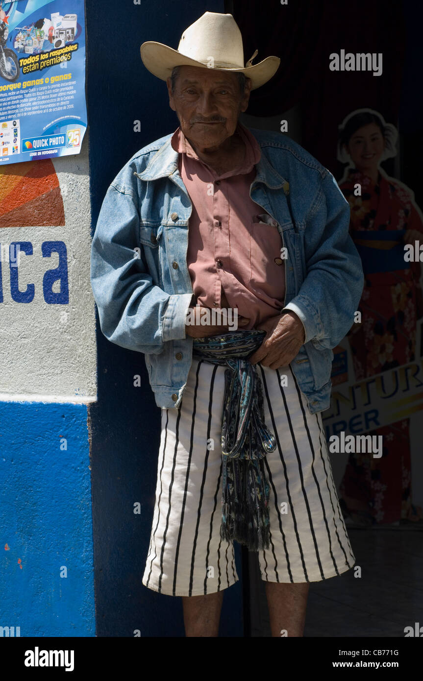 For the men of Santiago Atitlan in Guatemala a cowboy hat is traditionally accompanied not by jeans but by striped - Stock Image
