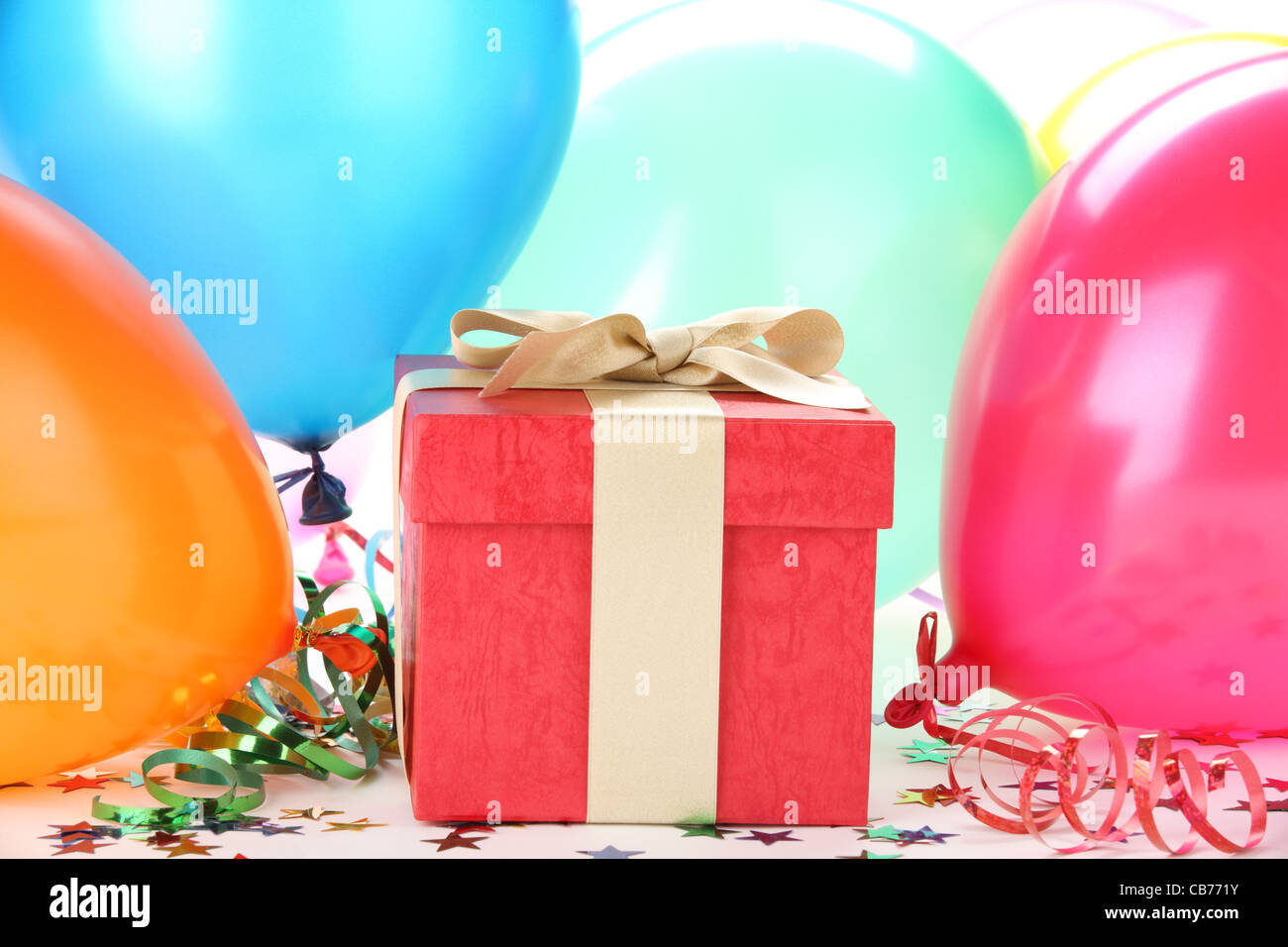 New Year's gift with balloons - Stock Image