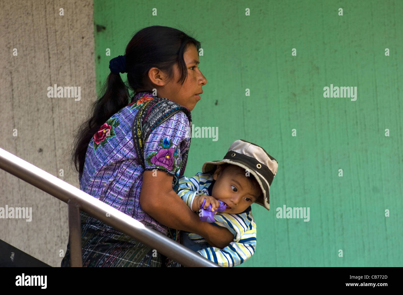 An indigenous Central American Indian baby in Santiago Atitlan looks as though he thinks his mother is going to - Stock Image