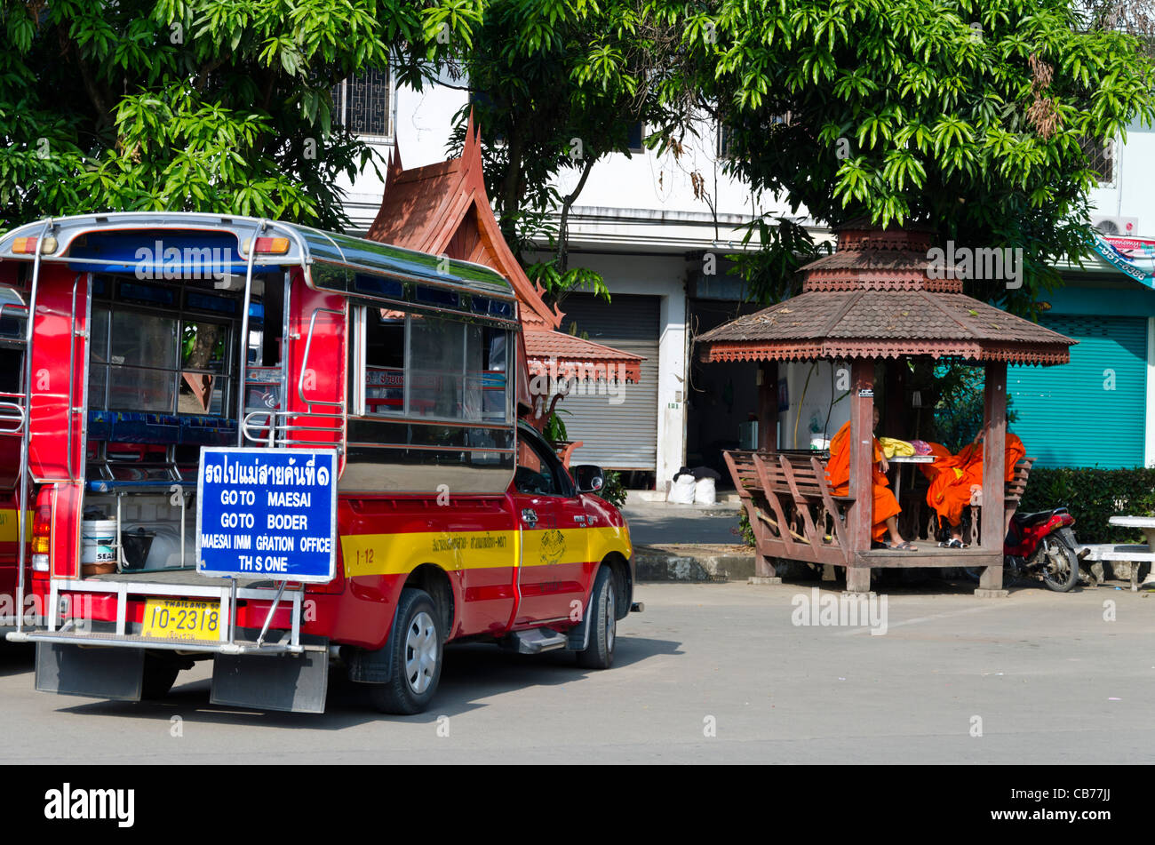 Songthaew parked at Mae Sai bus station in northern Thailand near Burma border. It has a sign 'Go to Maesai, - Stock Image