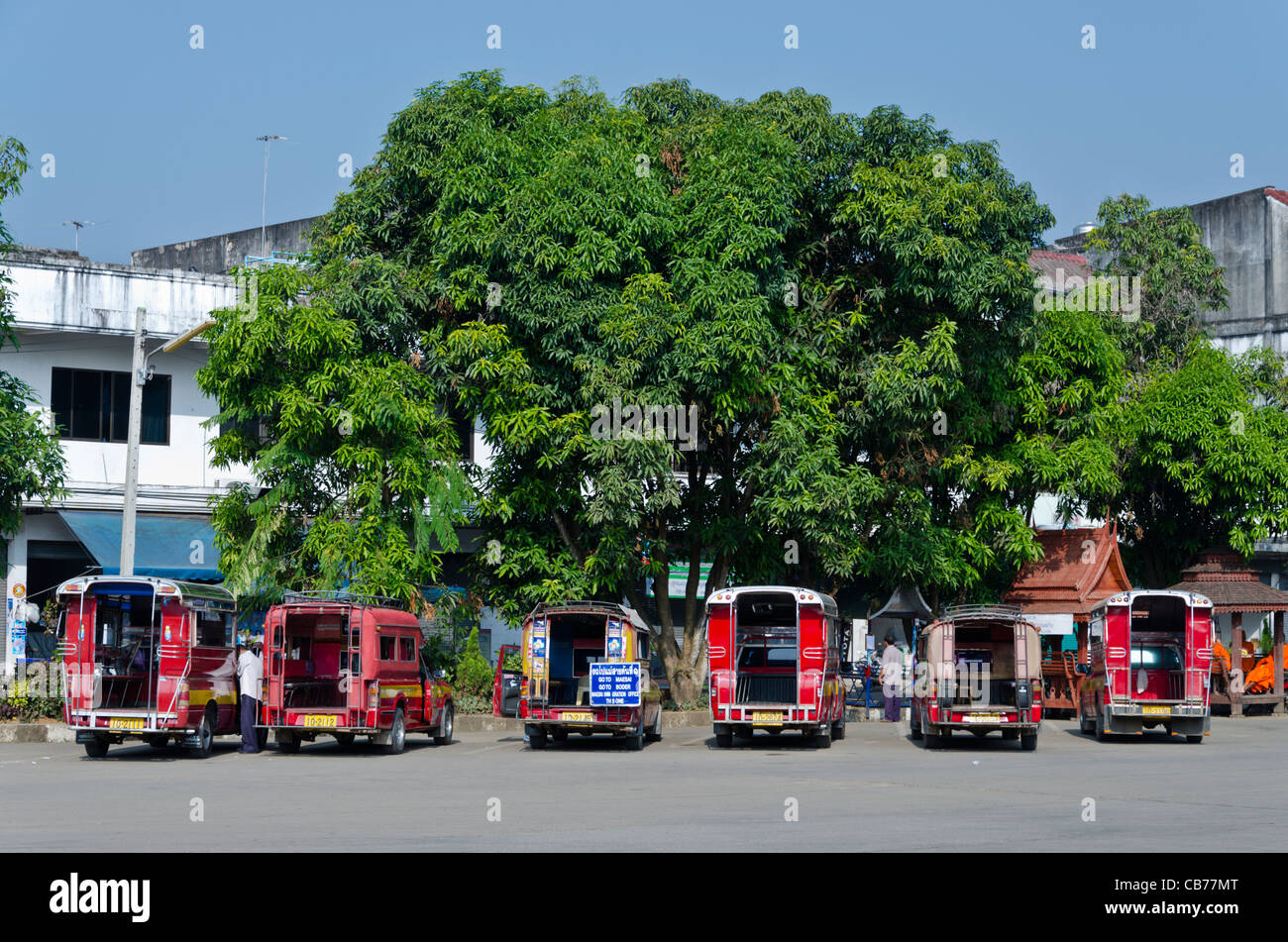 Songthaew parked at Mae Sai bus station in northern Thailand near Burma border. One has a sign 'Go to Maesai, - Stock Image