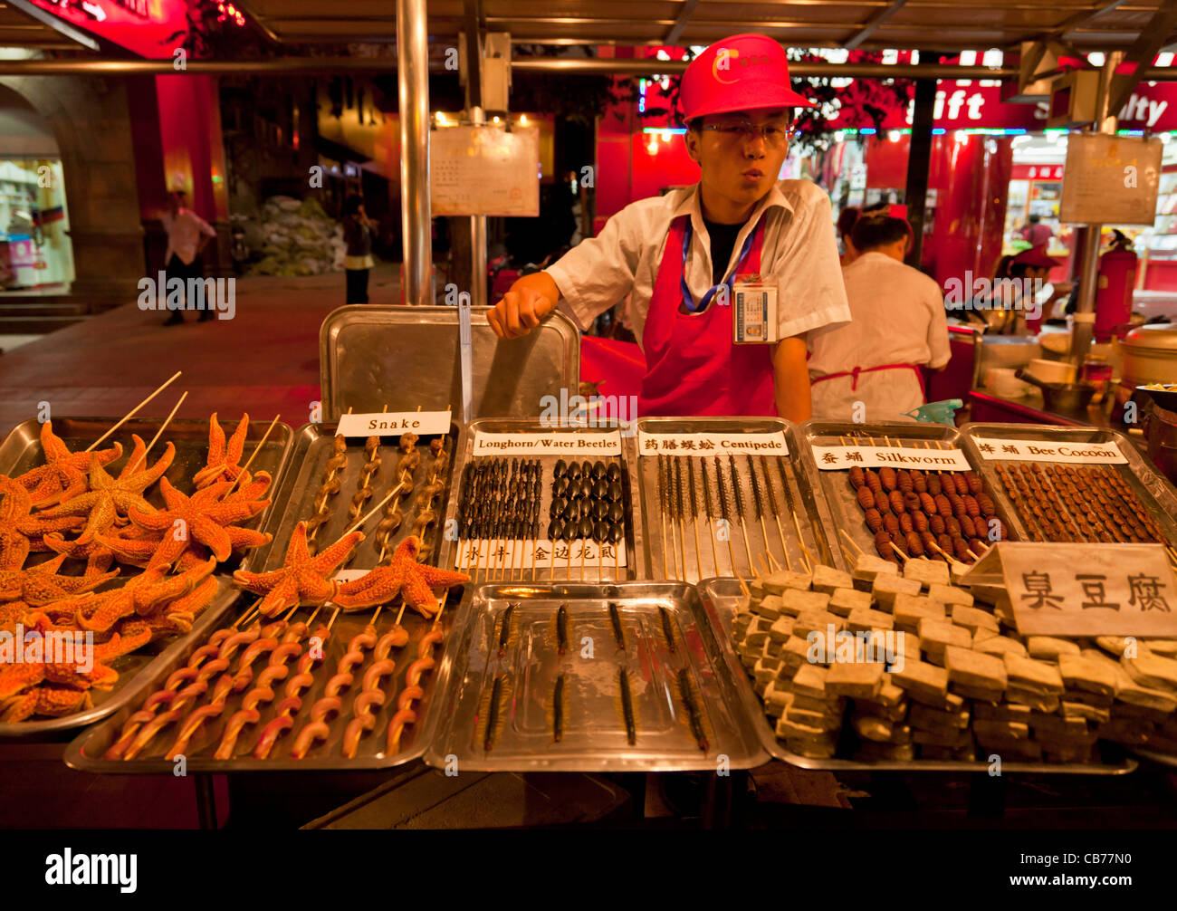 serving exotic food at the Wangfujing night market, Beijing,PRC Peoples Republic of China, Asia - Stock Image