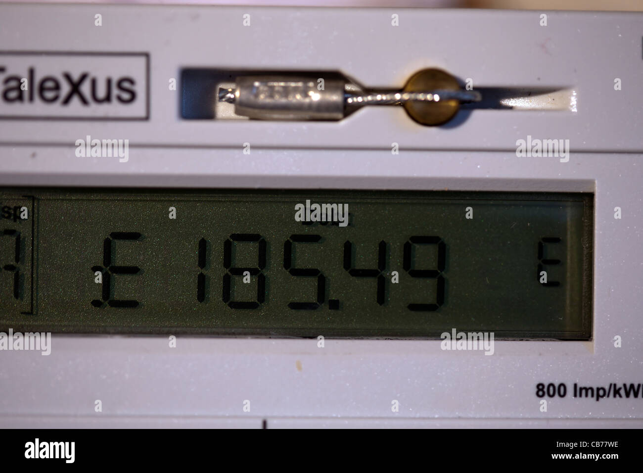 Debt Display _Electrical Supply and Distribution meter displaying an amount in debt - Stock Image